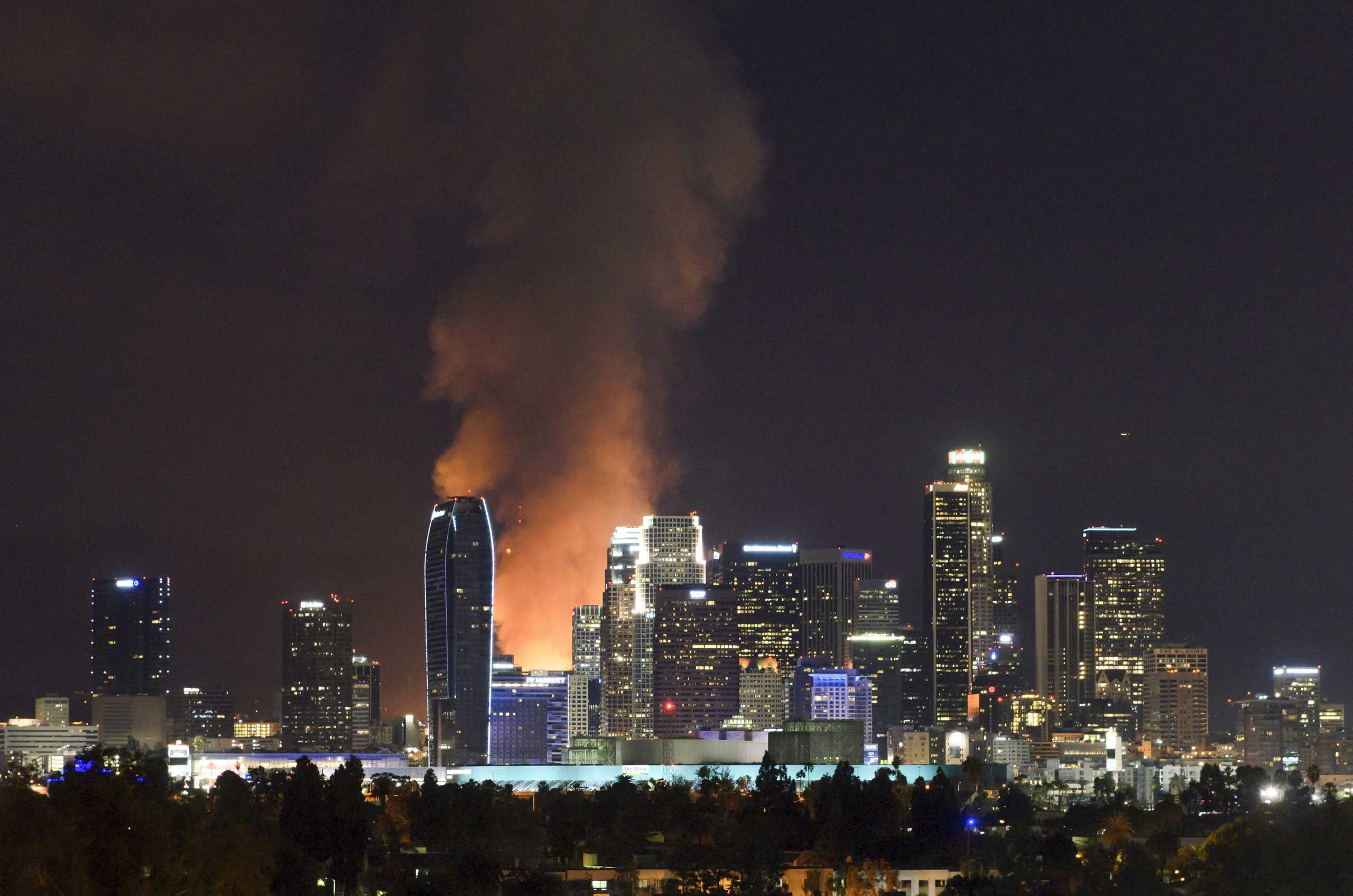 More than 200 firefighters work to control a fire that lit up the skyline as it destroys a seven-story building under construction in downtown Los Angeles on Dec. 8, 2014.