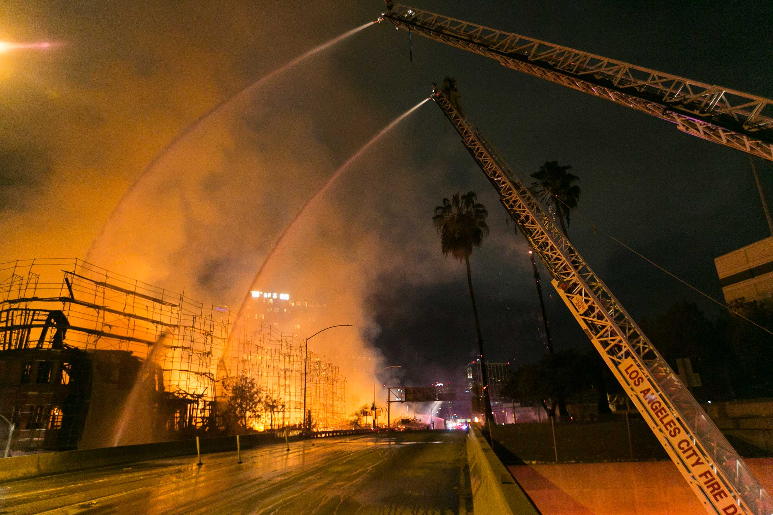 Firefighters battle a blaze at an apartment building under construction in Los Angeles on Dec. 8, 2014.