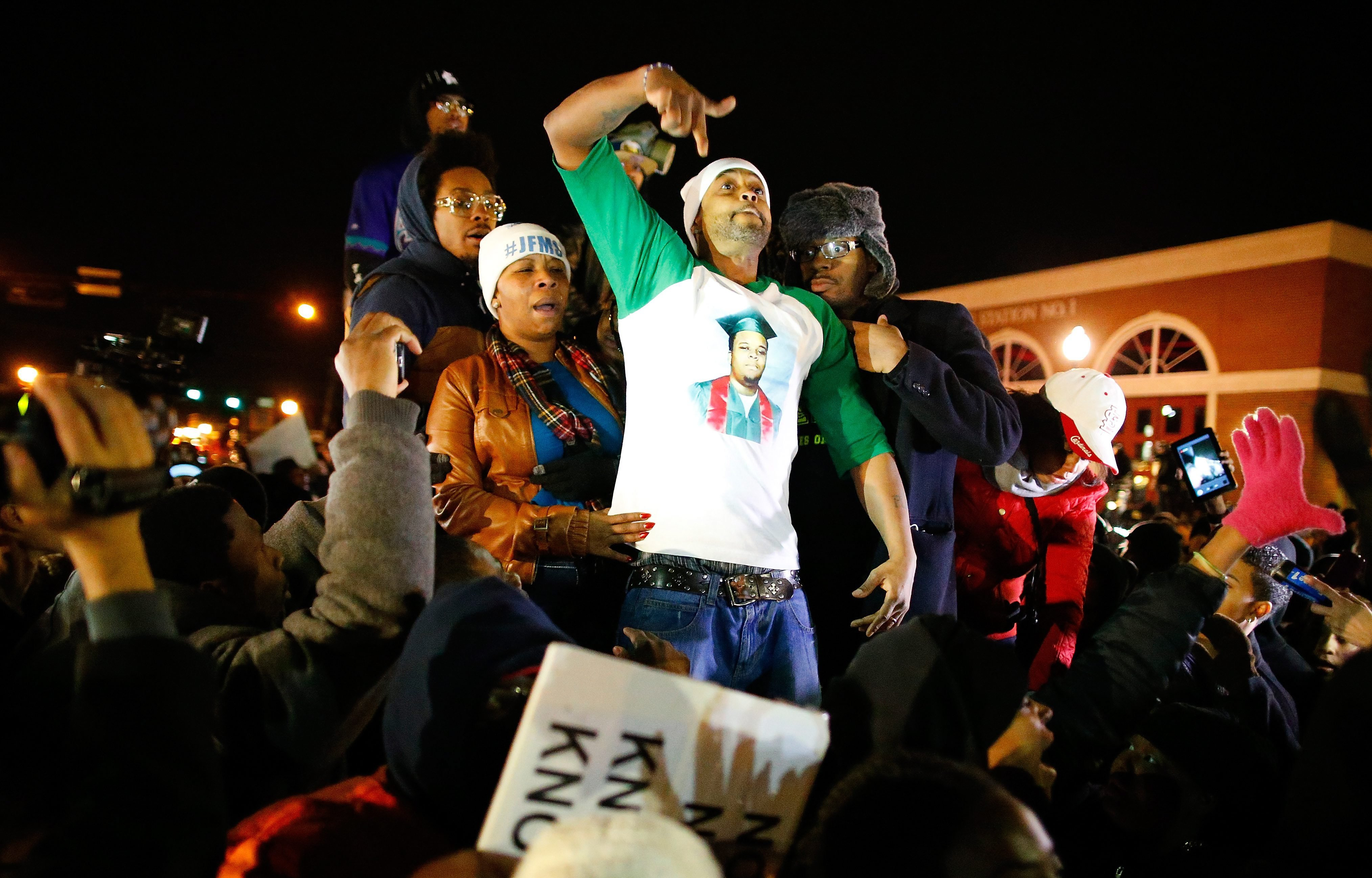 The mother of Michael Brown, Lesley McSpadden and her husband Louis Head gesture after the announced decision by the Grand Jury in FergusonMo. on Nov. 24, 2014.