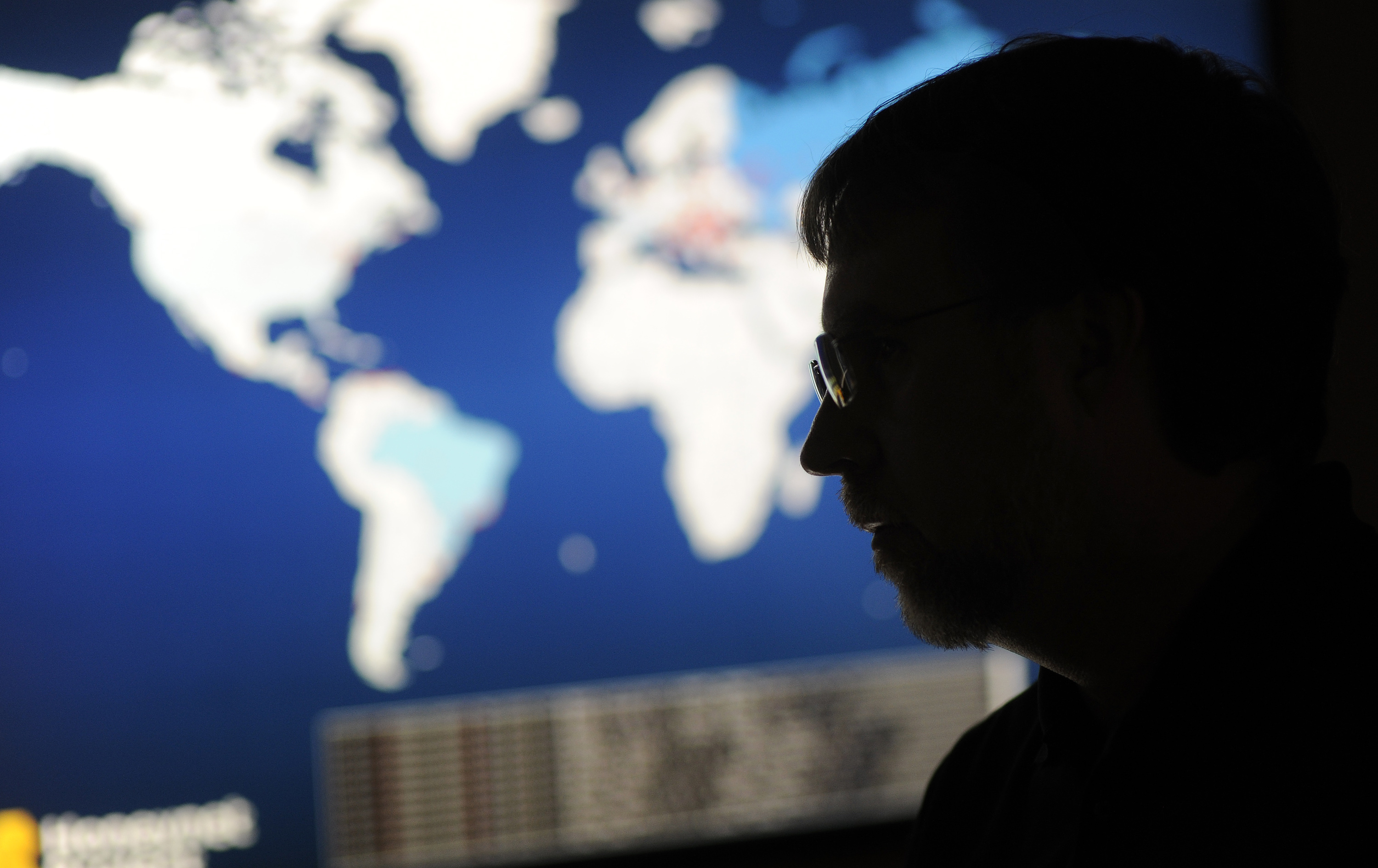 Joe Stewart, director of malware research at Dell SecureWorks, a unit of Dell Inc., speaks to a colleague in front of a pair of large wall mounted monitors in his office in Myrtle Beach, South Carolina, U.S., Friday, Jan. 18, 2013. S