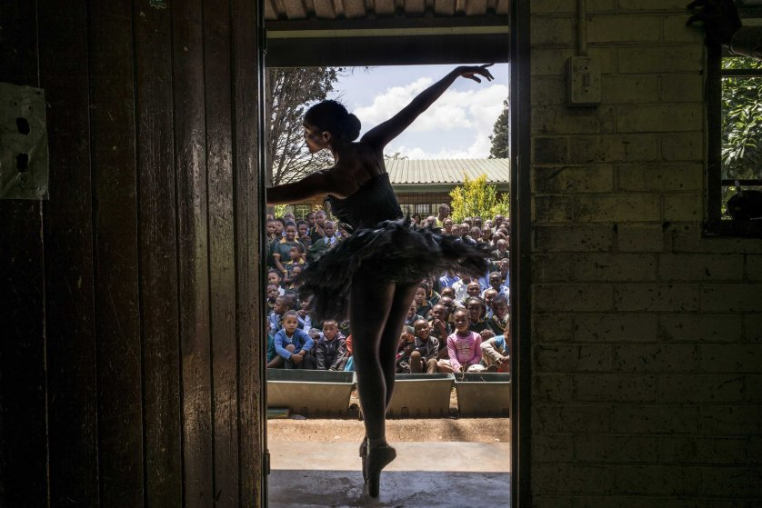 Senior soloist of the Joburg Ballet Kitty Phetla performs in a classroom at the Nka-Thuto Primary School in Soweto on Oct. 16, 2014.
