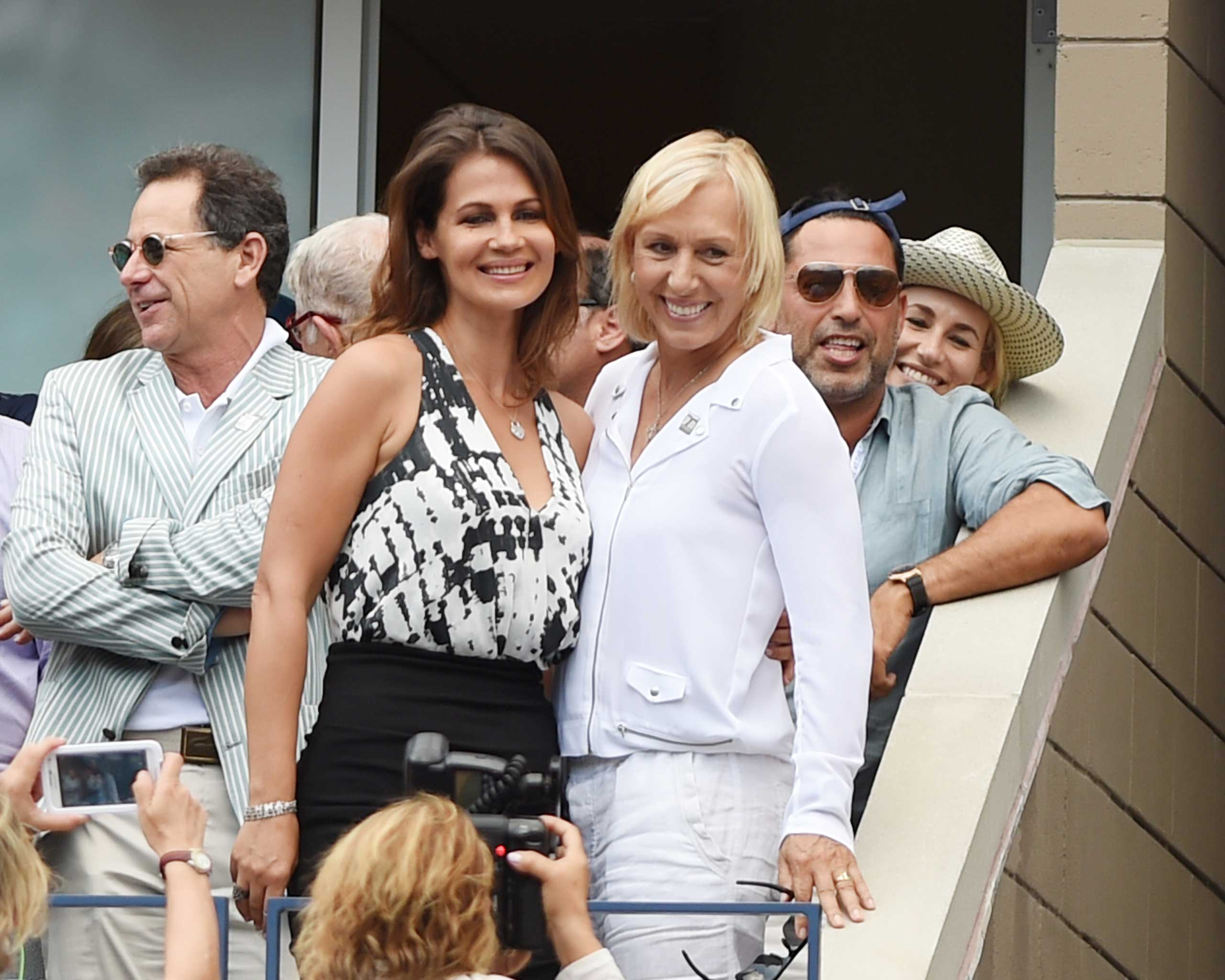 Martina Navratilova and Julia Lemigova celebrate their engagement during day 13 of the 2014 US Open at USTA Billie Jean King National Tennis Center on Sept. 6, 2014 in New York.