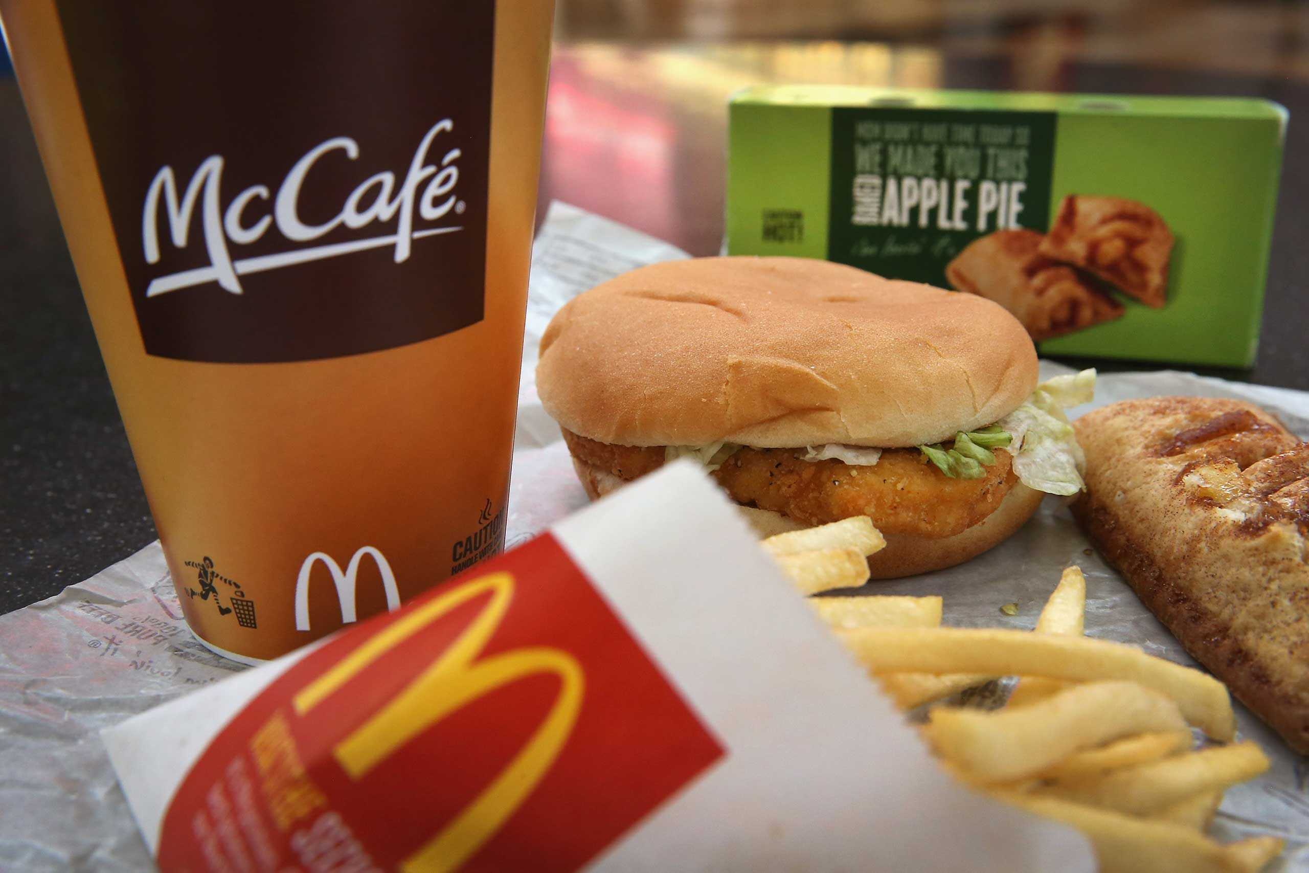 A McChicken sandwich sits with typical Dollar Menu items sold at a  McDonald's restaurant.