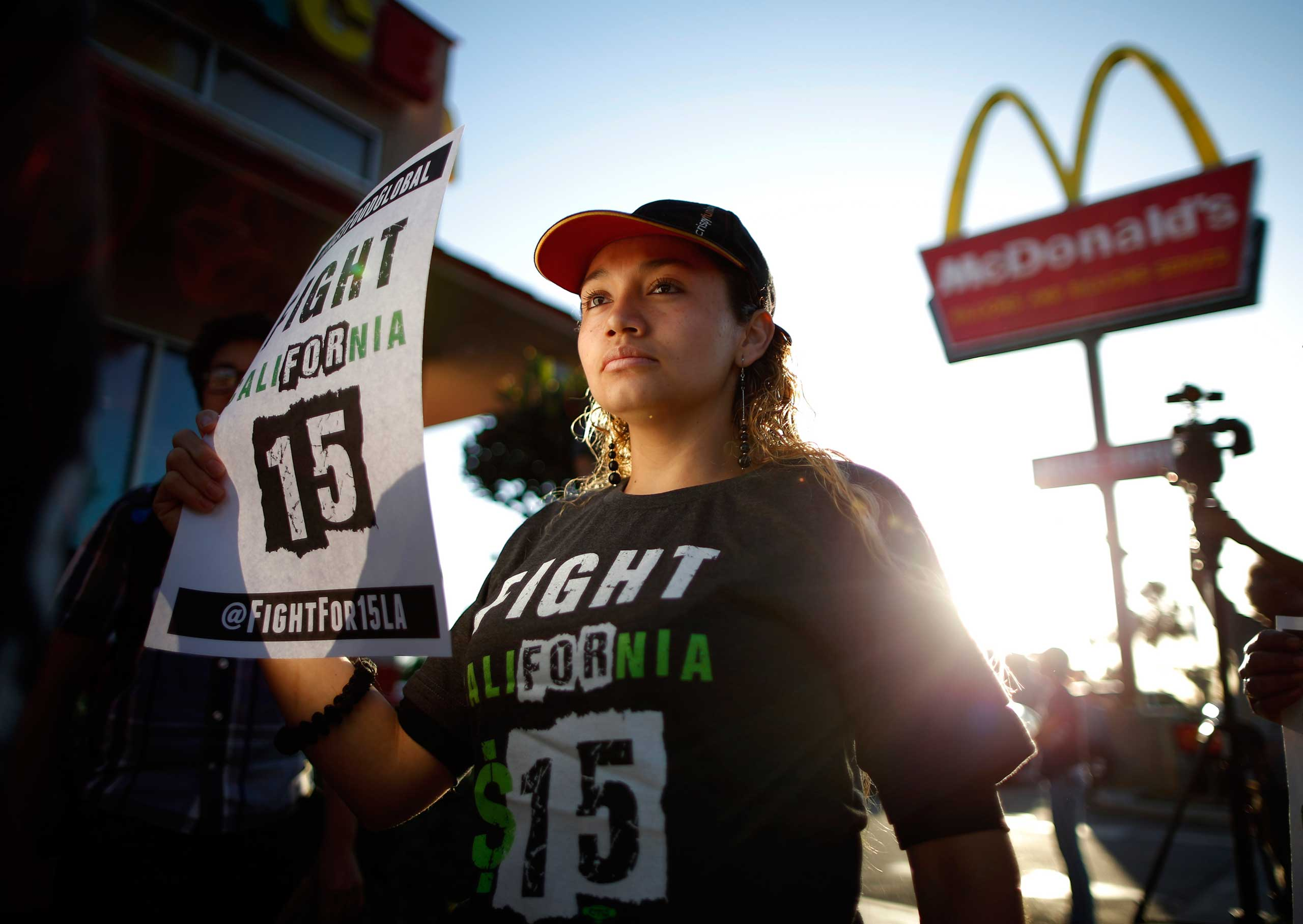 United States:  Protests demanding higher wages for fast-food workersDemonstrators take part in a protest to demand higher wages for fast-food workers outside McDonald's in Los Angeles, May 15, 2014.