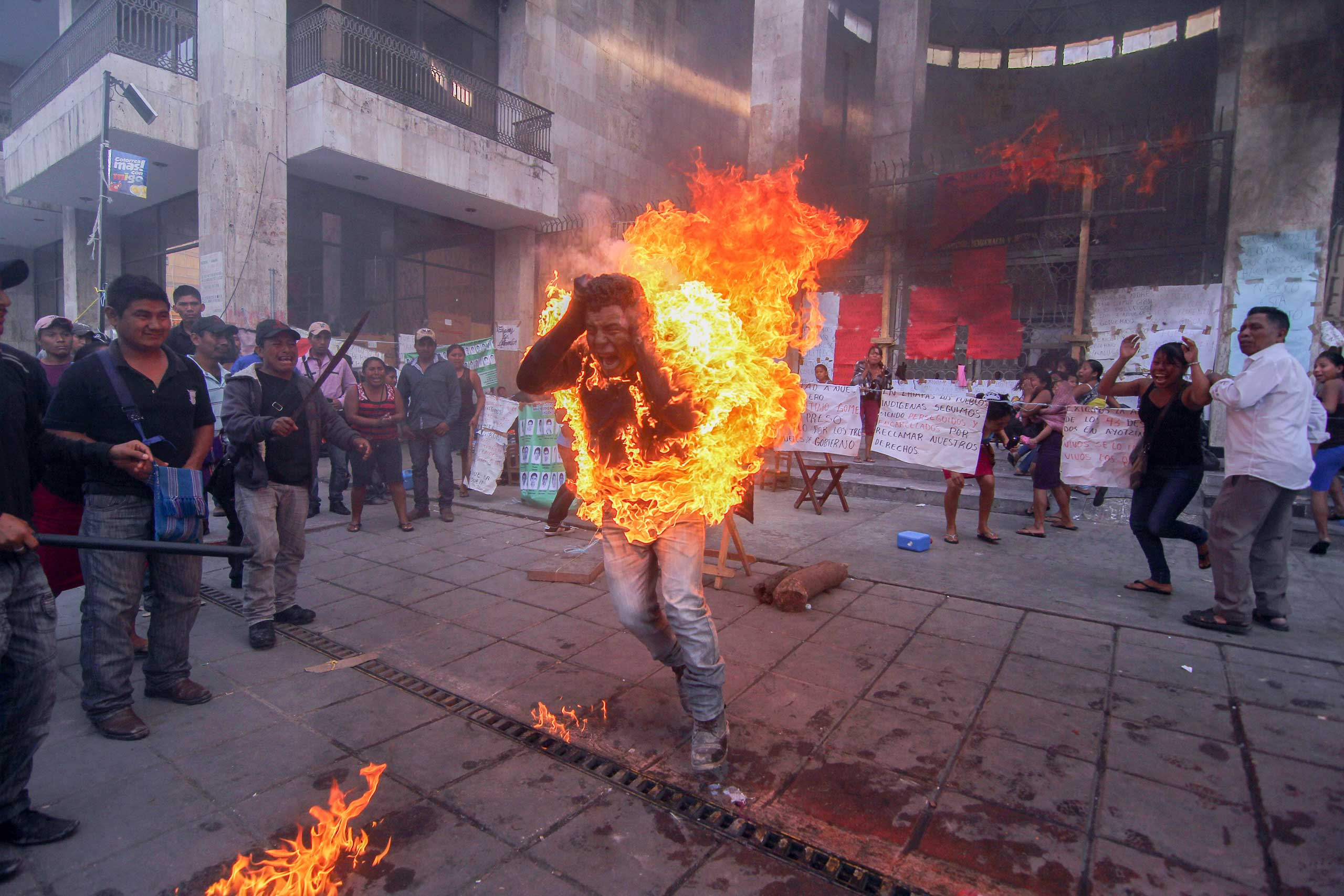 Mexico: Protests over indigenous rightsFarmer Agustin Gomez Perez, 21, runs engulfed in flames after he was lit on fire as a form of protest outside the Chiapas state legislature in Tuxtla Gutierrez, Mexico, Dec. 5, 2014. Perez was demanding the release of his father, indigenous leader Florentino Gomez Giron, who was arrested last year on charges stemming from a series of demonstrations in 2011 that turned violent.