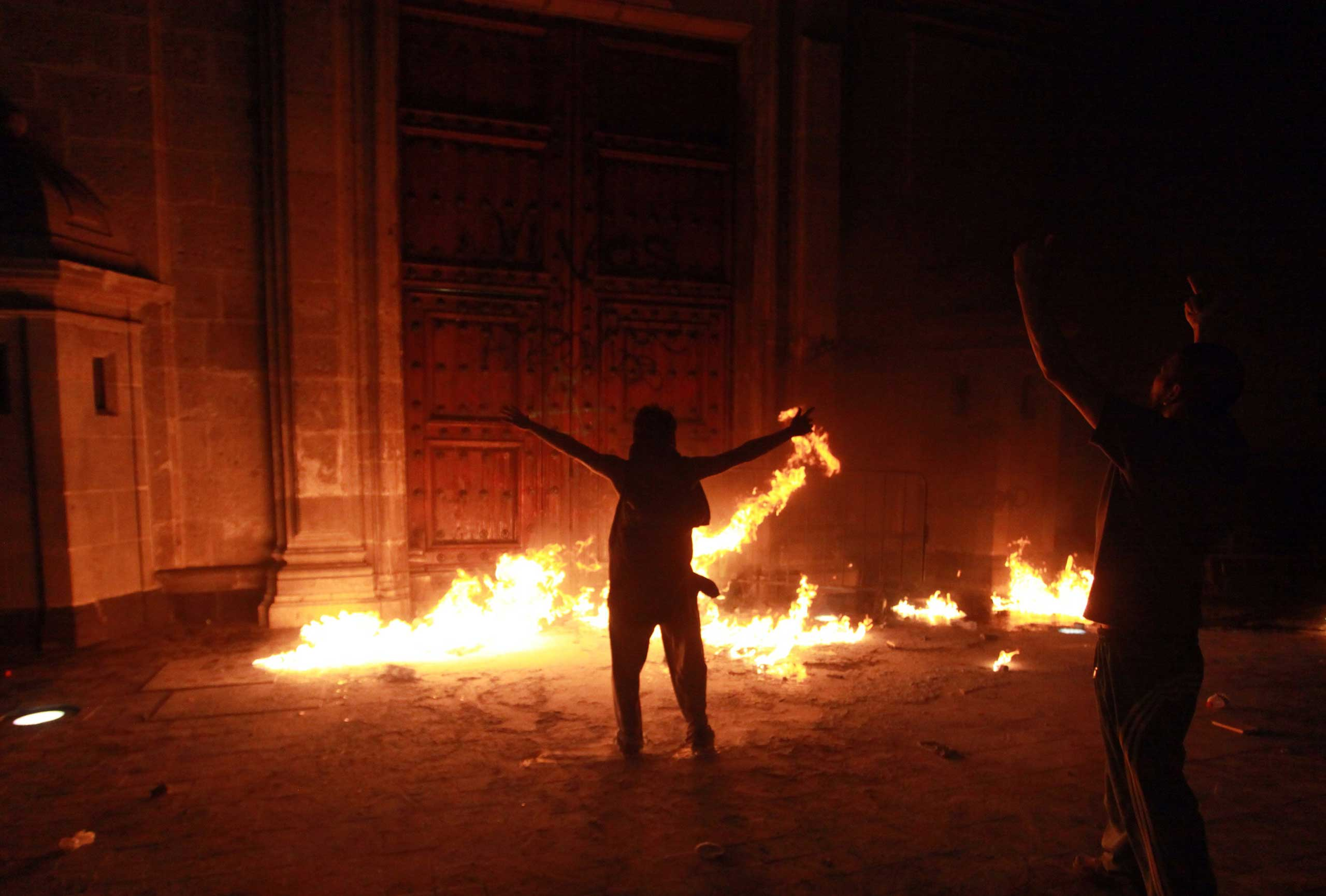 Mexico: Protests over the disappearance of 43 studentsDemonstrators set on fire a door of the National Palace in Mexico City, Nov. 8, 2014.
