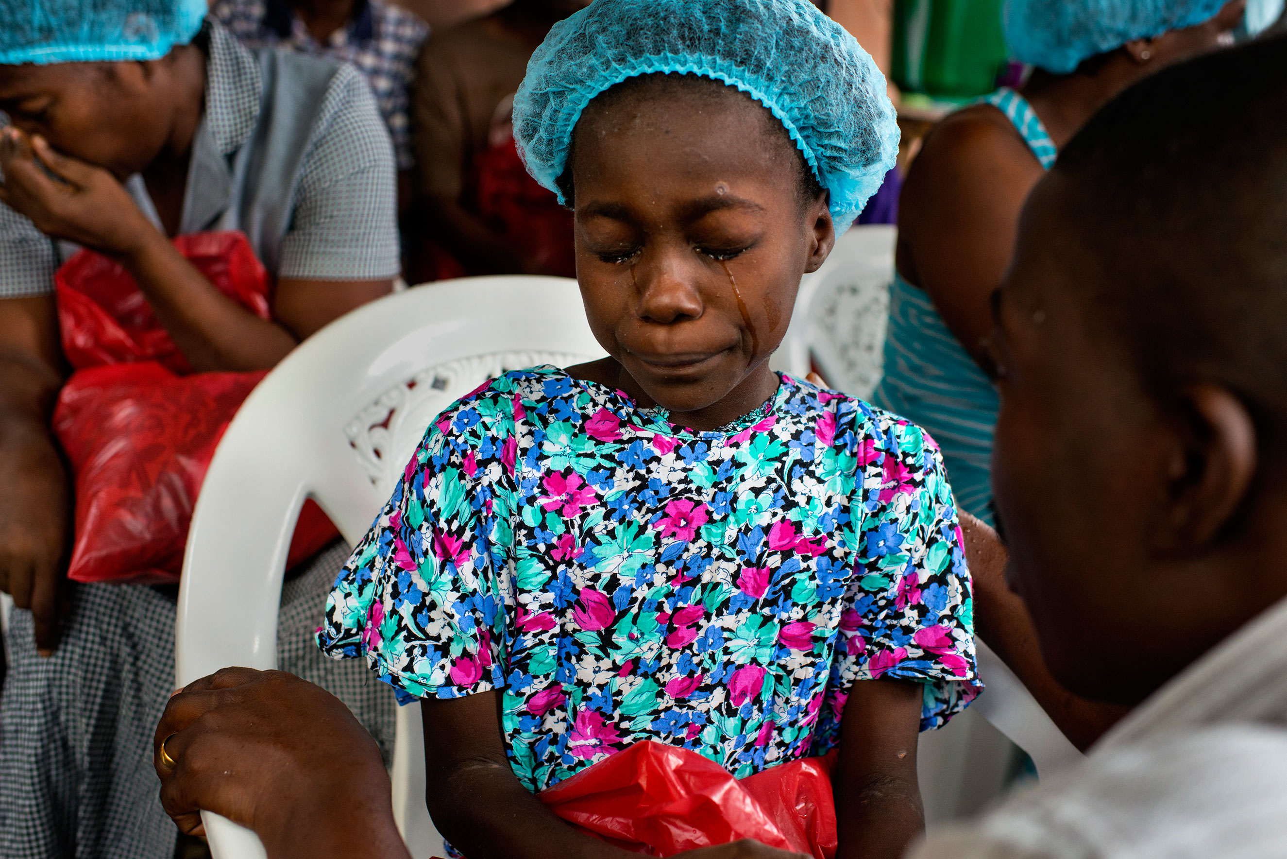Esther Tokpah, 11 an orphan, weeps as Dr. Jerry Brown tries to console her before she was released from care on Sept. 24, 2014 in Monrovia, Liberia. Esther lost both parents to Ebola.