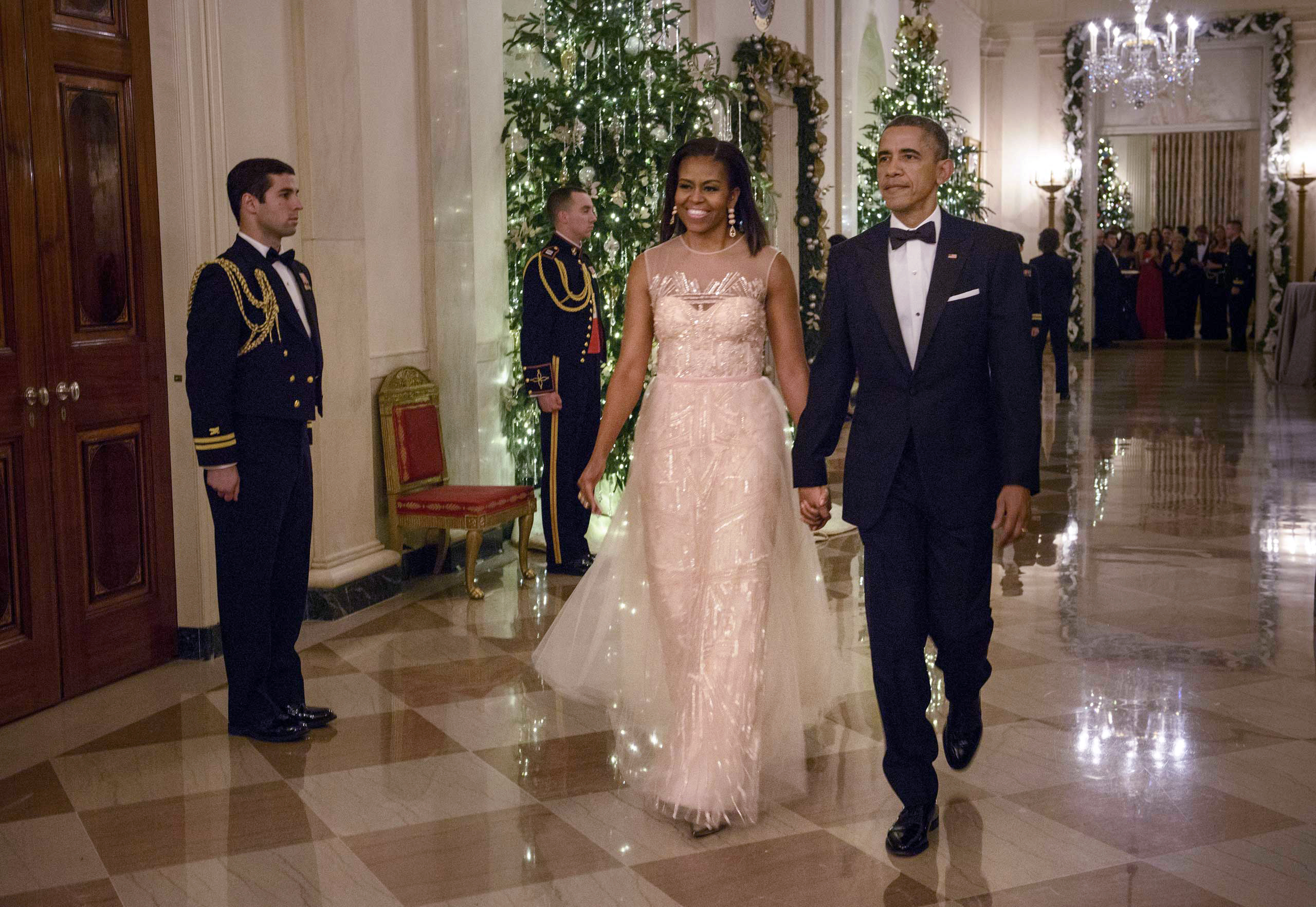 Ending the year in style, and mirroring the White House Christmas decorations, Obama wore this dress by Monique Lhuiller to the Kennedy Center honors in December.