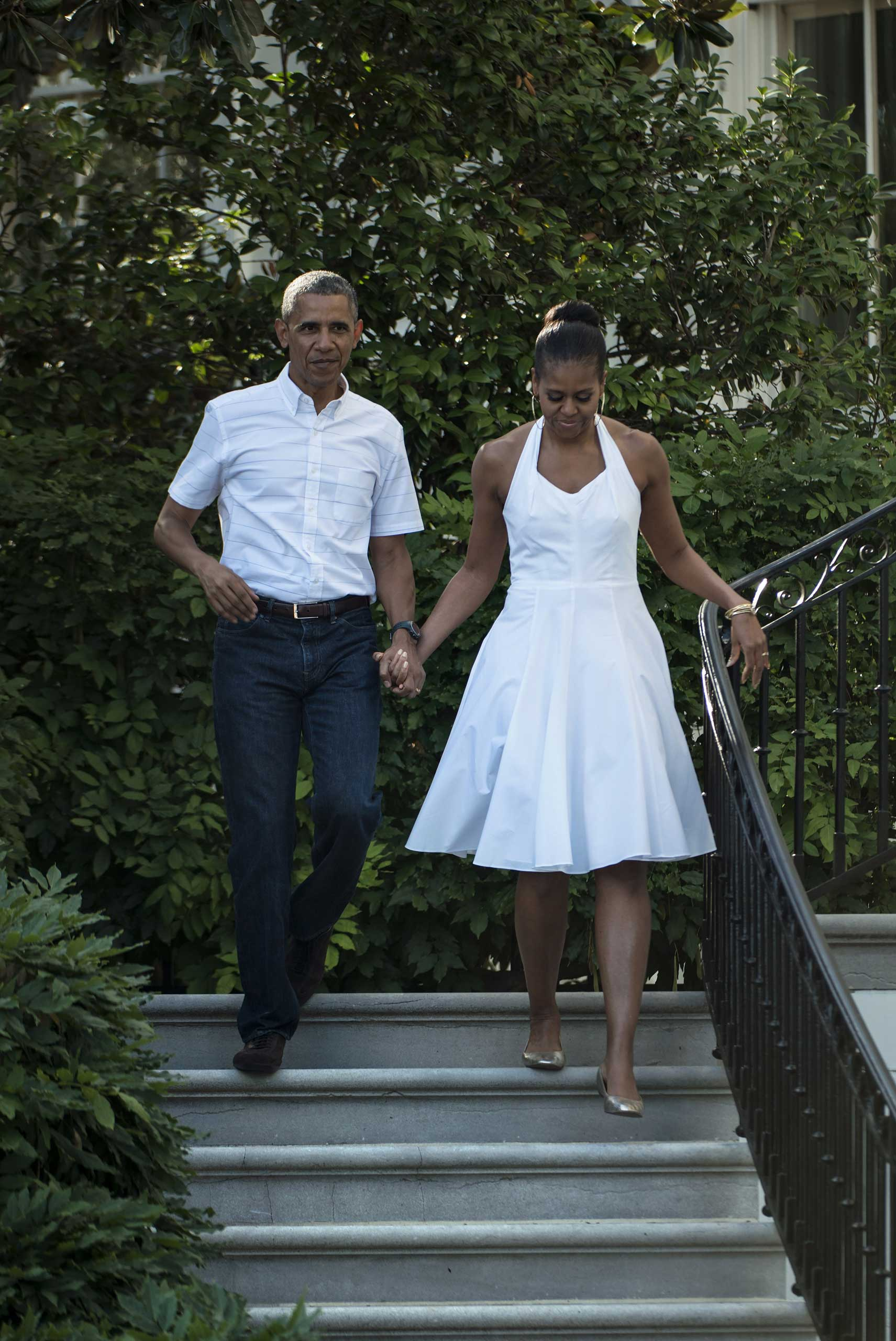 The president may have gone for jeans, but Michelle Obama was ready for summer, wearing a crisp white summer dress to the White House Fourth of July celebration.