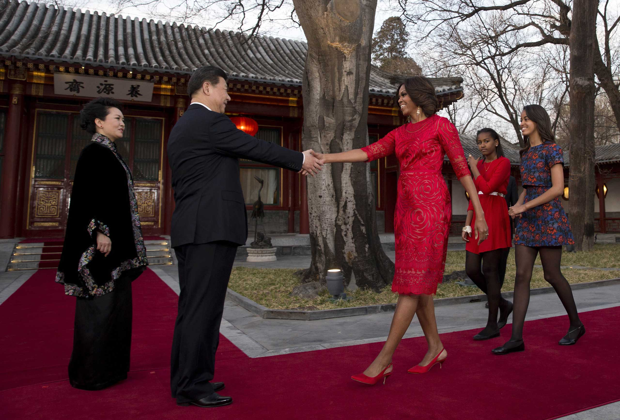 During a visit to Beijing in March to meet with Chinese President Xi Jinping, Obama wore a custom dress by Naeem Khan which updated the traditional Chinese red dress — and her daughters didn't look too bad either.