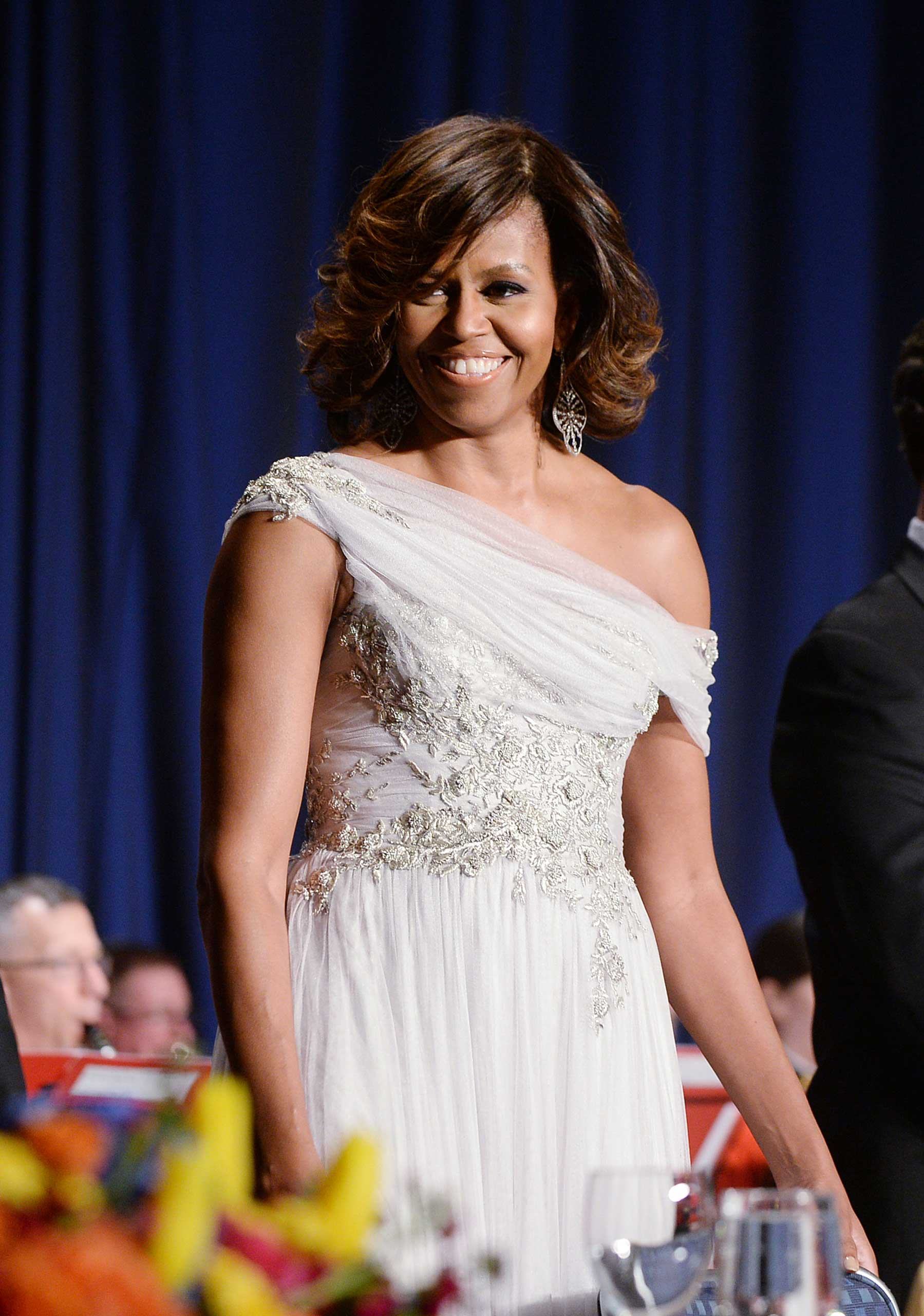 The White House Correspondents' Dinner is often jokingly called Nerd Prom, but Obama's choice of a grey tulle embroidered dress from Marchesa was neither nerdy nor prom-like.