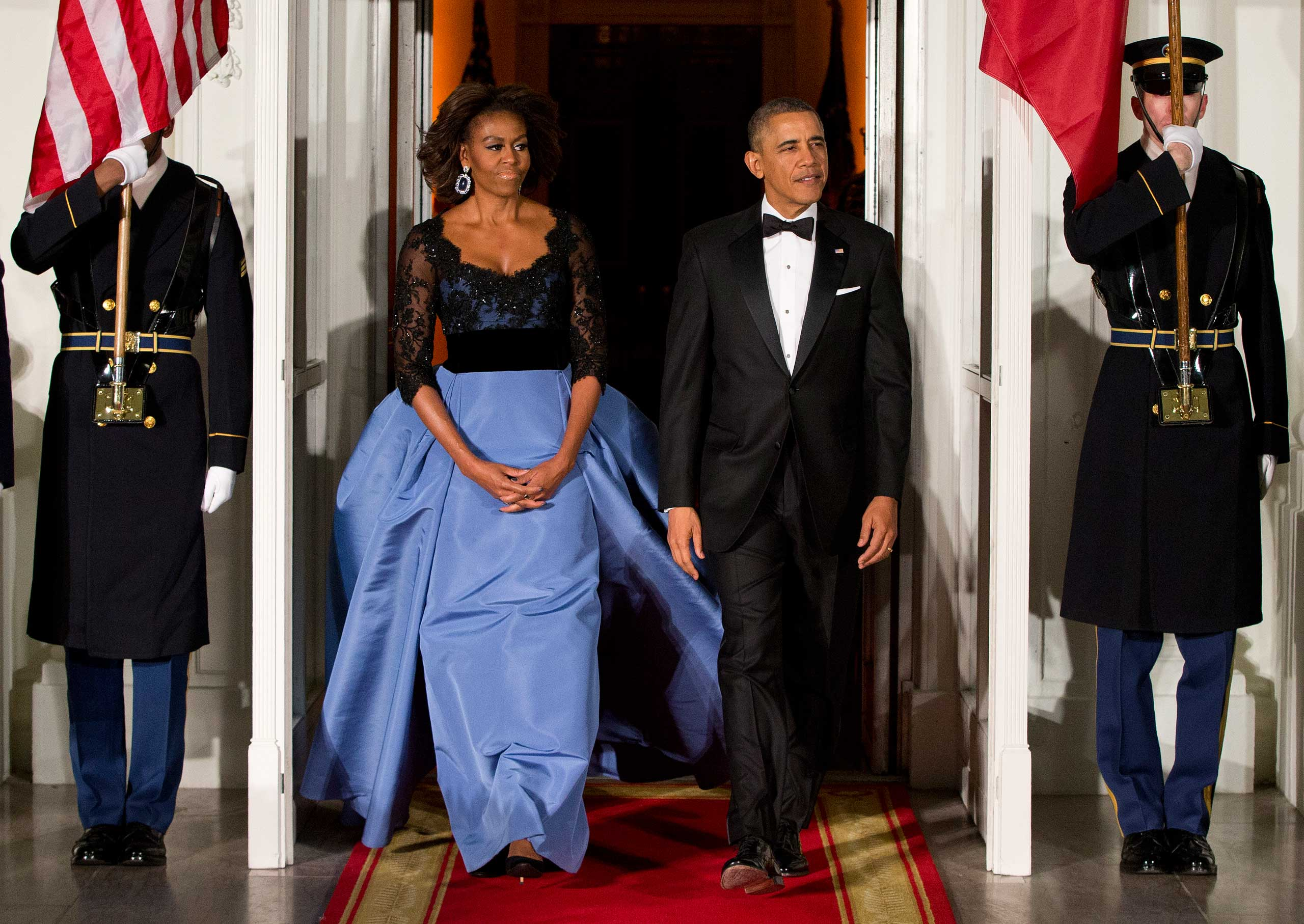 Obama won plaudits for this powder blue and black lace gown by Carolina Herrera, which she wore to a state dinner with Hollande in February.
