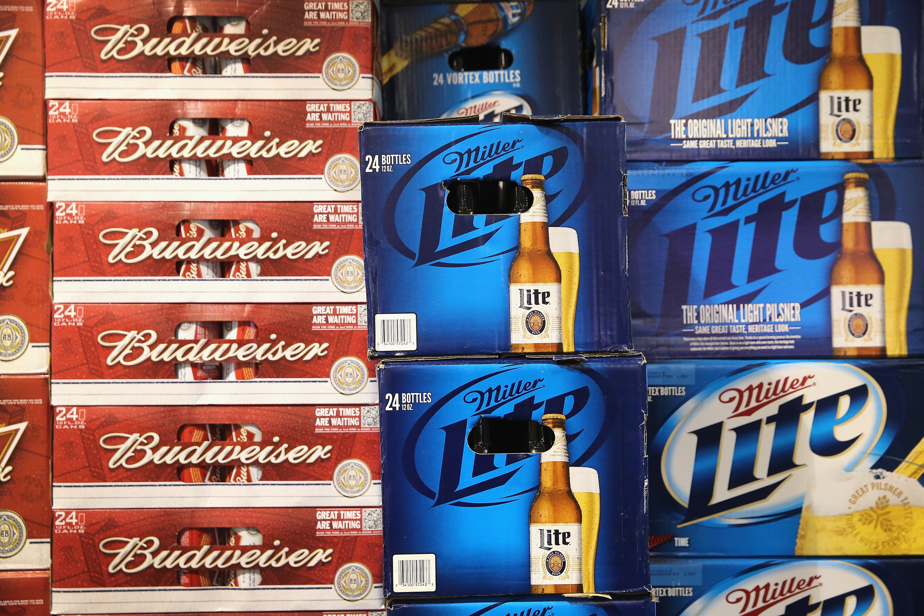 SABMiller and Anheuser-Busch InBev products are offered for sale on September 15, 2014 in Chicago. Illinois. Share of SABMiller have surged to an all-time high today on speculation of a takeover bid by Anheuser-Busch InBev, the world's largest brewer.