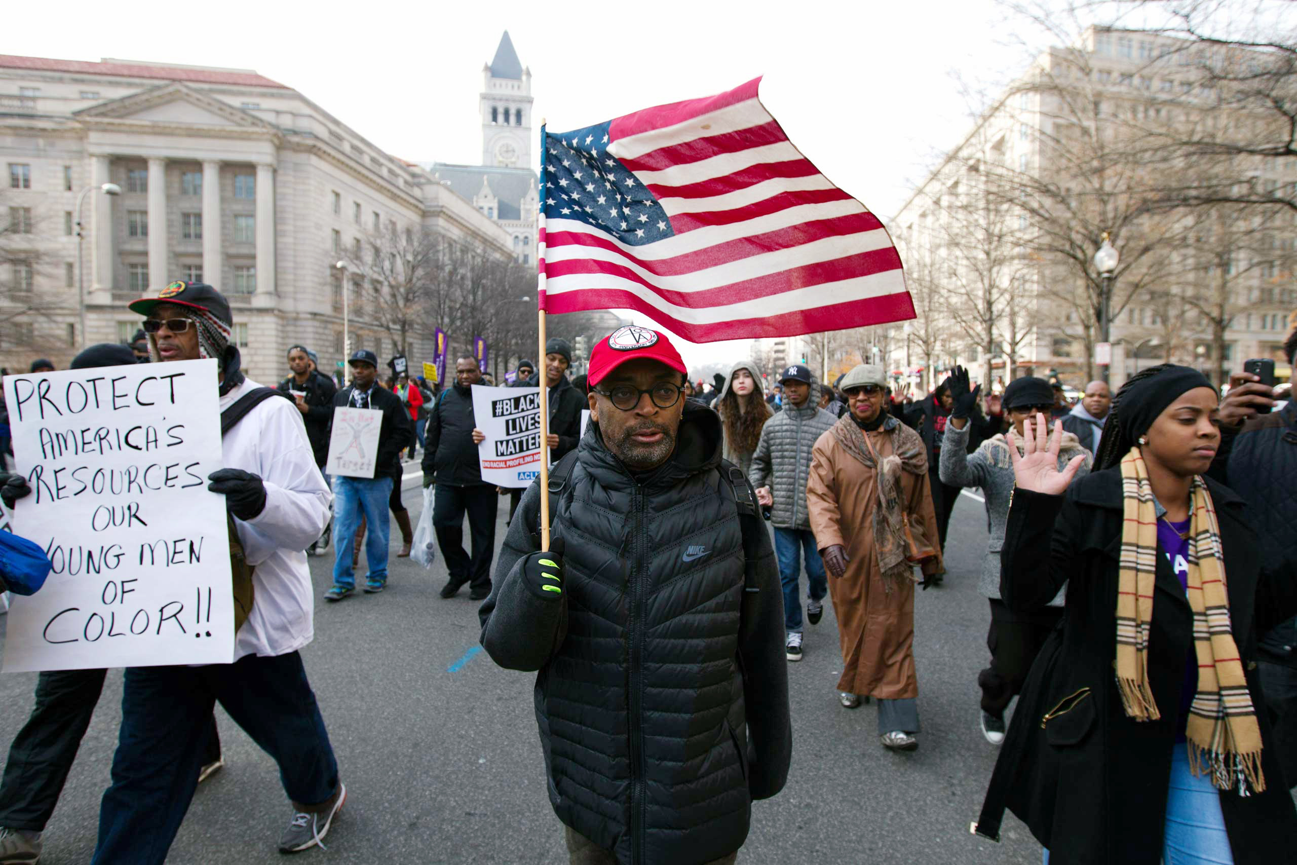 Film director Spike Lee, and others, march on Pennsylvania Avenue toward Capitol Hill in Washington, on Dec. 13, 2014.