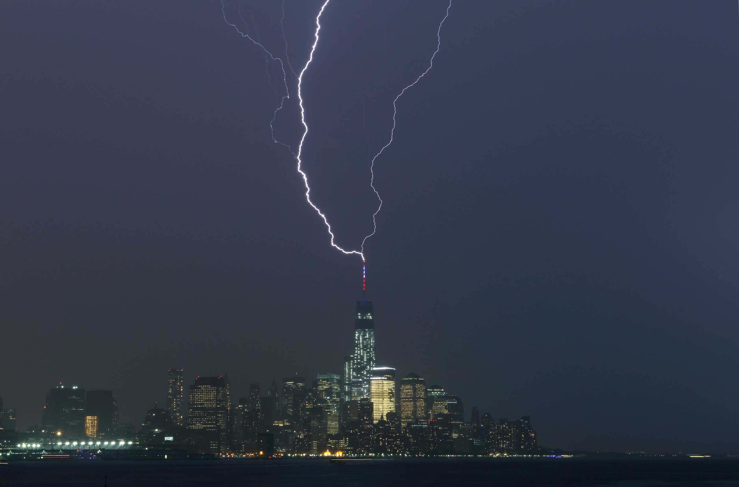 Two bolts of lightning hit the antenna on top of One World Trade Center, New York, May 23, 2014.