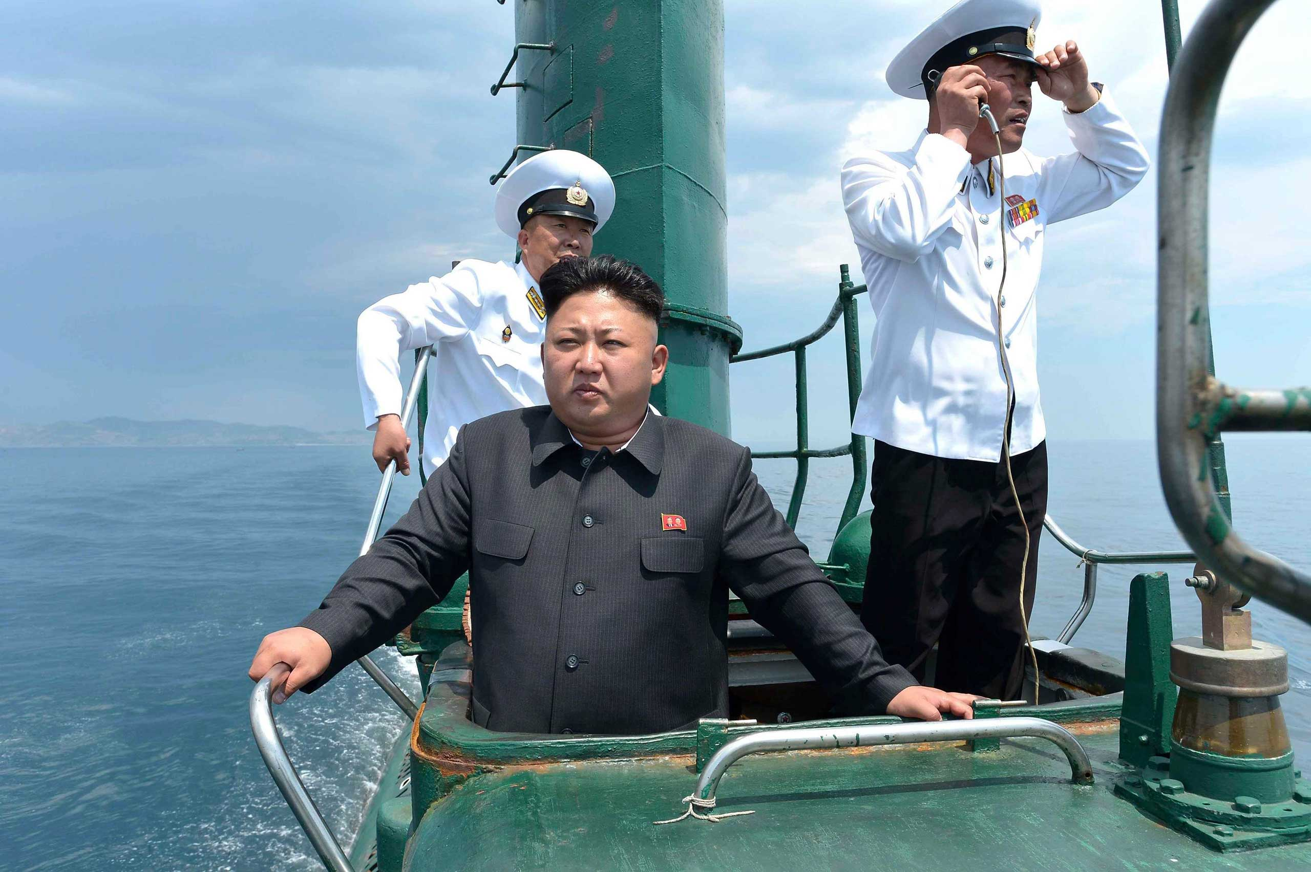 Kim Jong Un, North Korean leader, looks out                               from the submarine of a Korean People's Army                               naval unit during an inspection in this undated photo released by North Korea's Korean Central News Agency (KCNA) in Pyongyang, June 16, 2014.