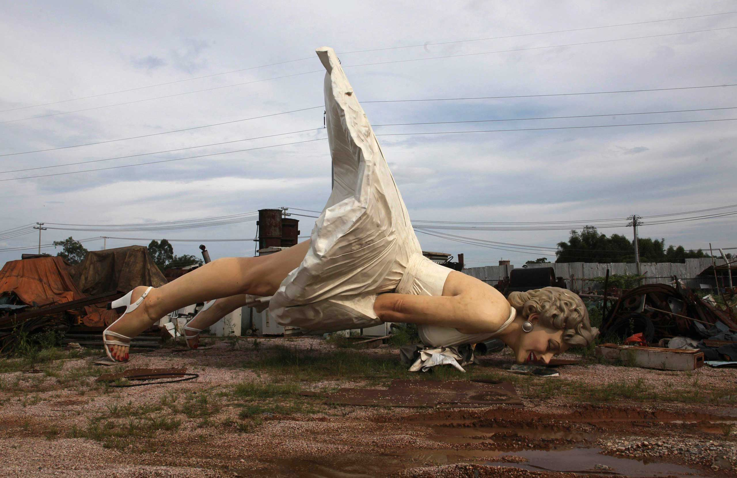 A giant statue of actress Marilyn Monroe is seen at the landfill site of a garbage collecting company in Guigang, Guangxi Zhuang Autonomous Region, China, June 18, 2014.