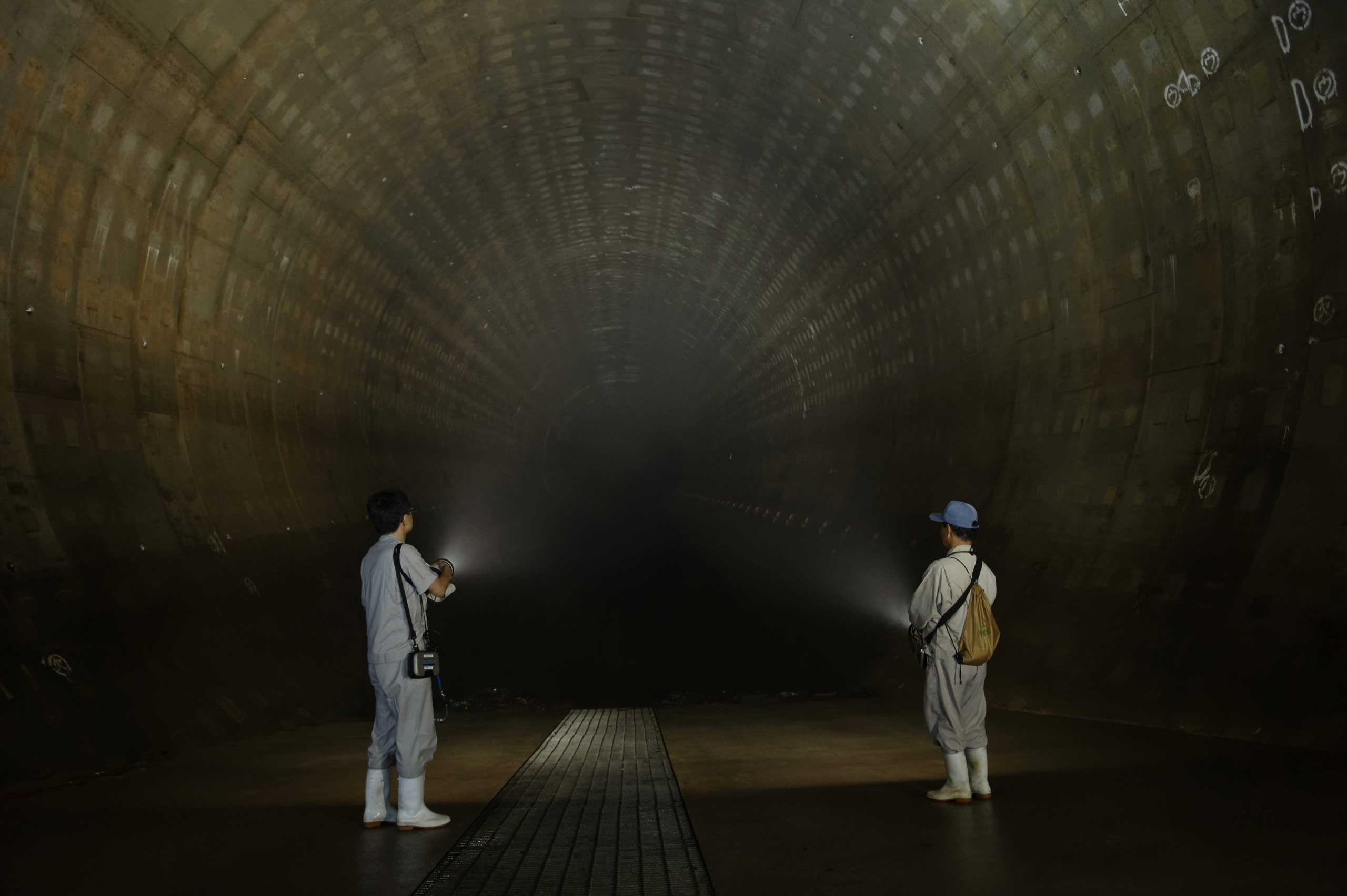 Tokyo Metropolitan Government employees are seen lighting a large underground regulating reservoir in Tokyo, July, 28, 2014.