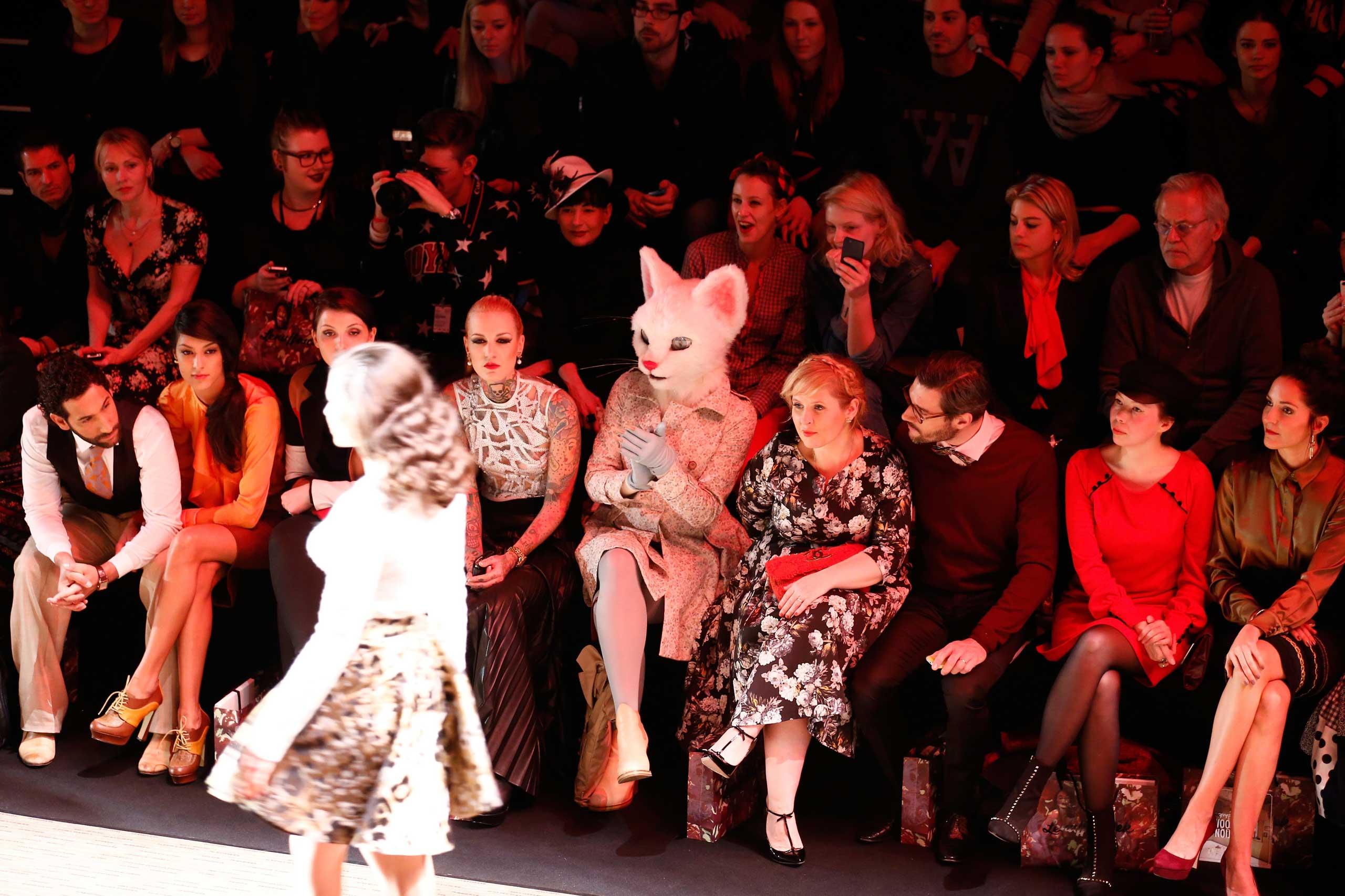 From left to right, Massimo Sinato, Rebecca Mir, Lexy Hill, Maite Kelly, Florent Raimond, guest, Johanna Klum attend the Rebekka Ruetz show during Mercedes-Benz Fashion Week Autumn/Winter 2014/15 at Brandenburg Gate in Berlin, Jan. 14, 2014.
