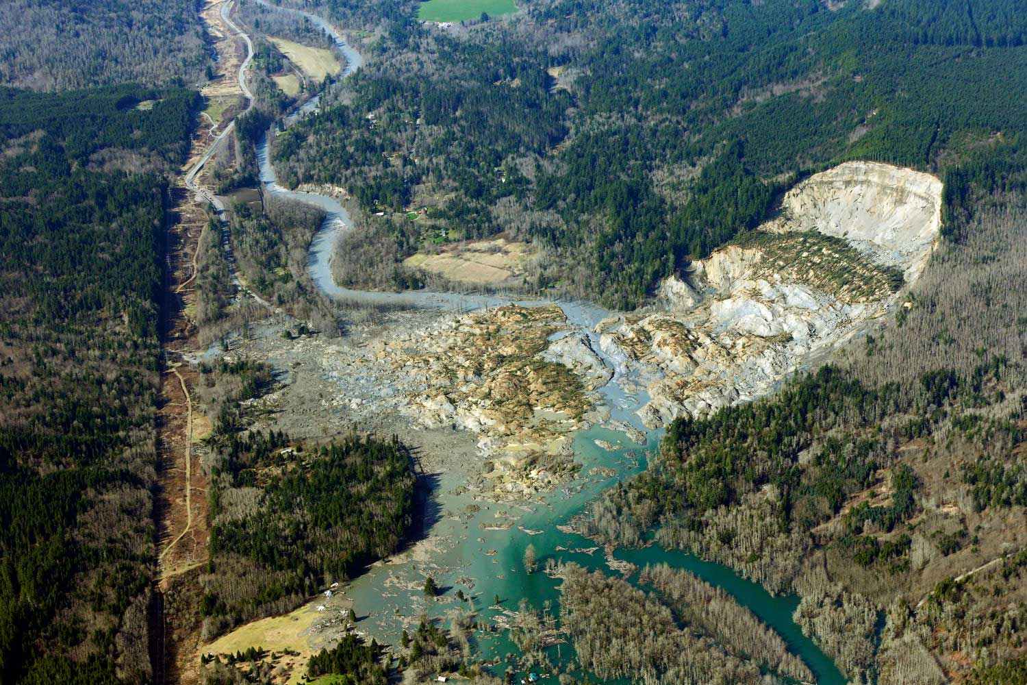 This aerial photo shows a massive mudslide that killed at least eight people and left dozens missing near Arlington, Wash., March 24, 2014.