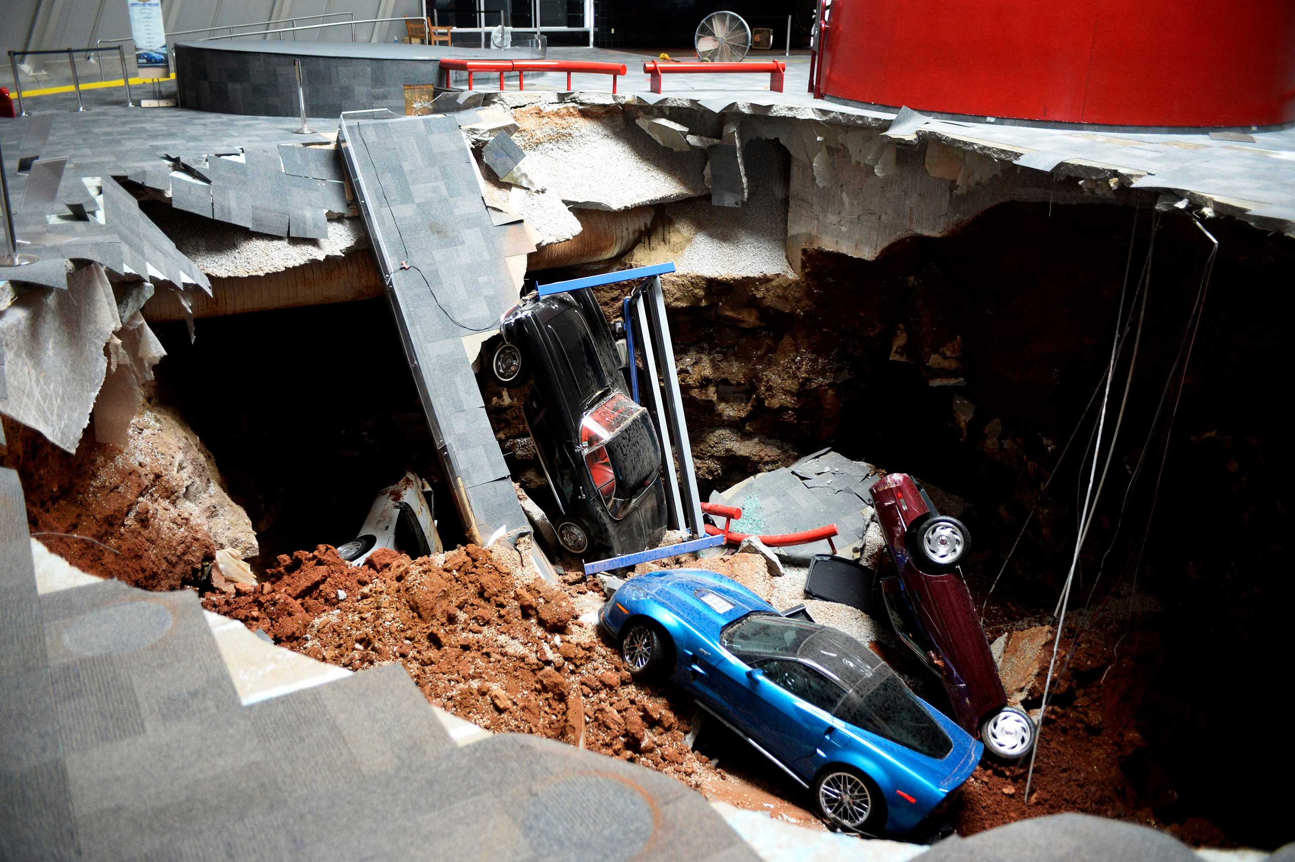 A sinkhole swallows eight classic and historic Corvettes at the National Corvette Museum in Bowling Green, Ky., Feb. 12, 2014.