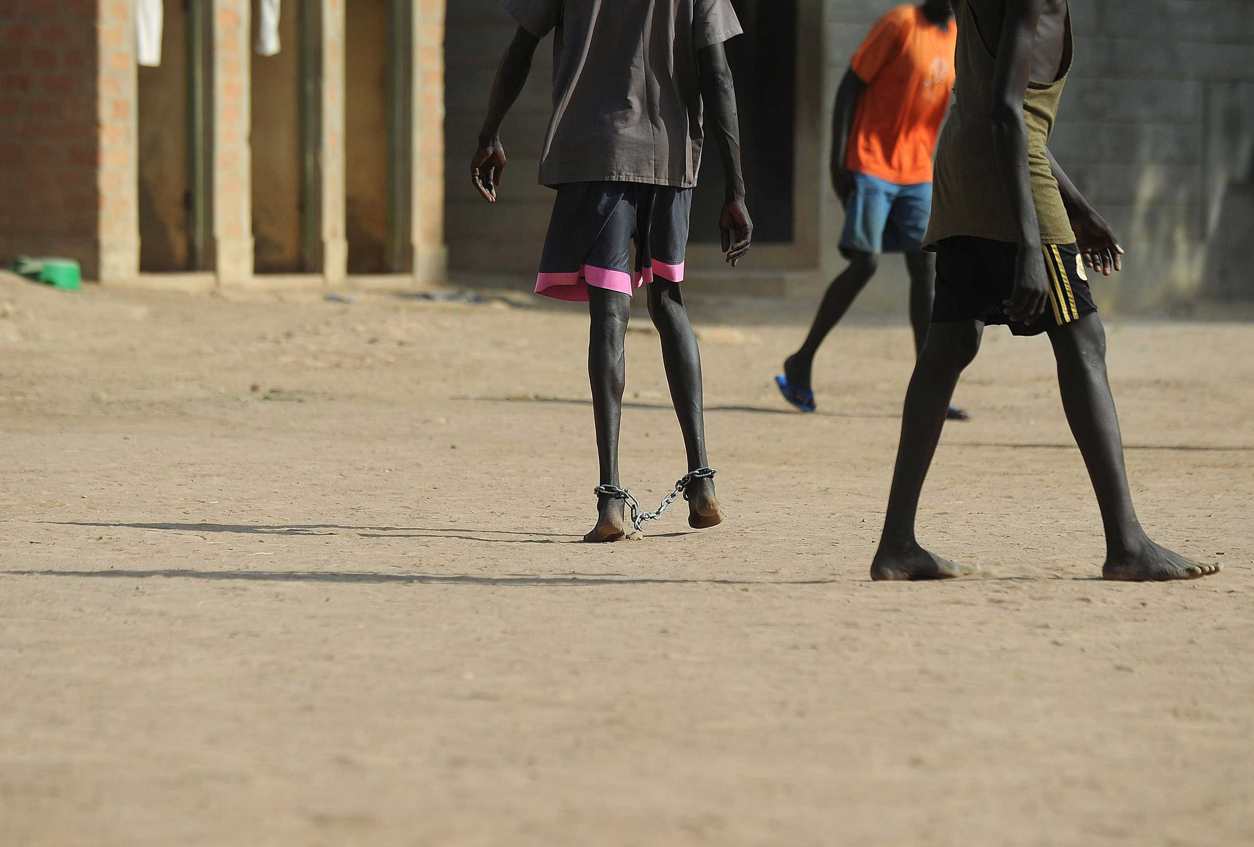 Inmates play football in the courtyard of the prison facility in Rumbek, Lakes state in South Sudan, Feb. 19, 2014.