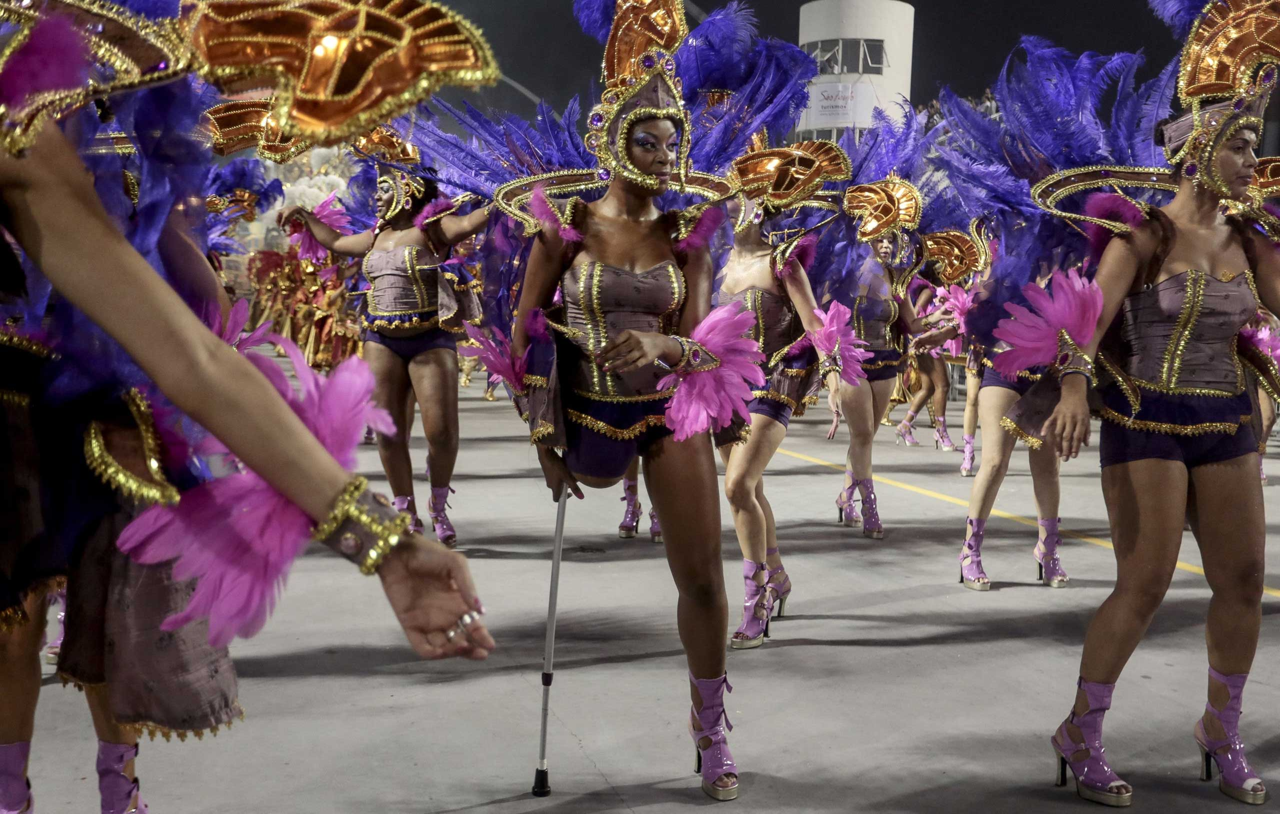 Revelers of the Nene de Vila Matilde samba school perform during the second night of carnival parade at the Sambadrome, Sao Paulo, March 1, 2014.