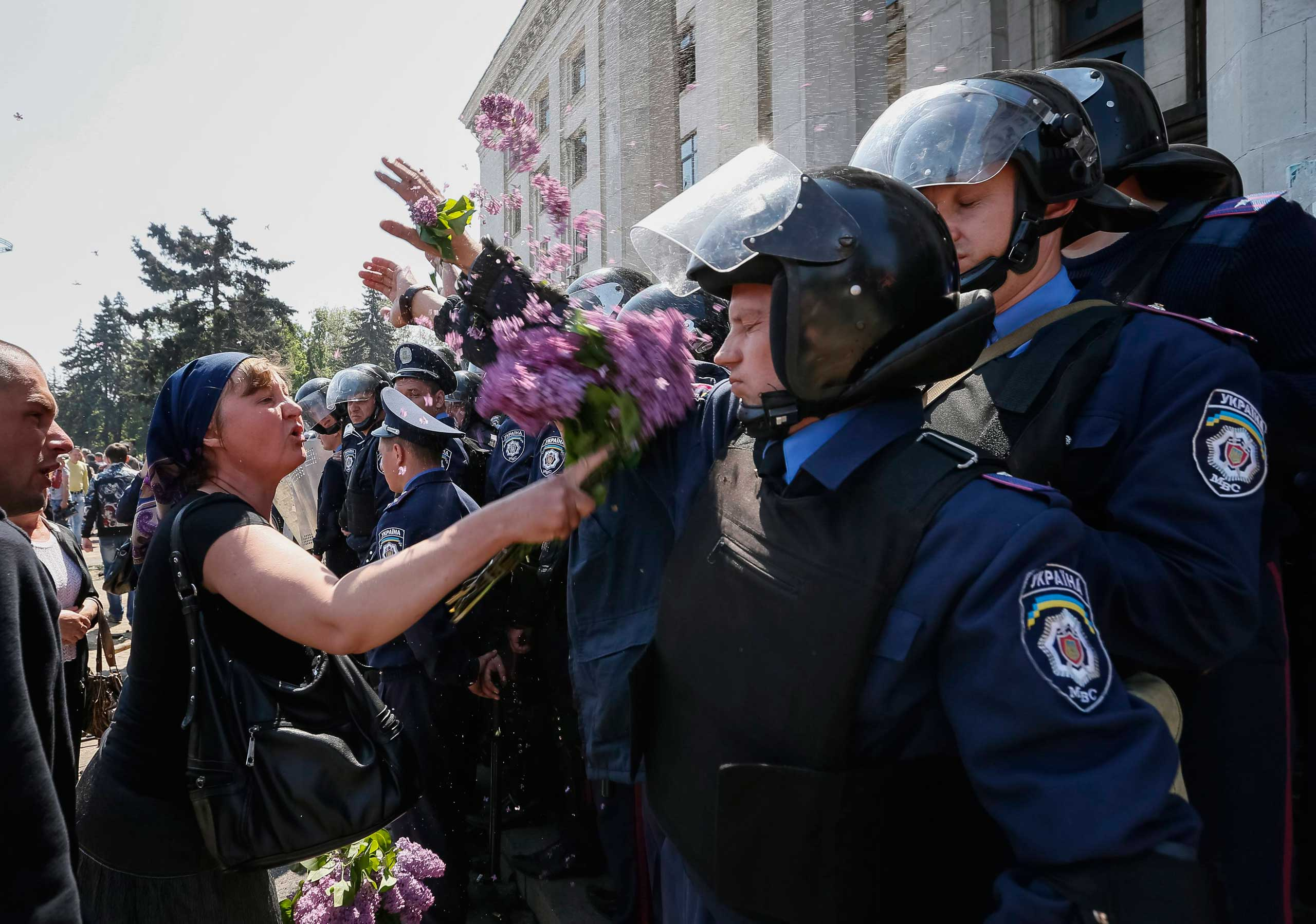 A woman argues with members from the Ukrainian Interior Ministry security forces during a rally outside a trade union building Odessa, May 3, 2014.