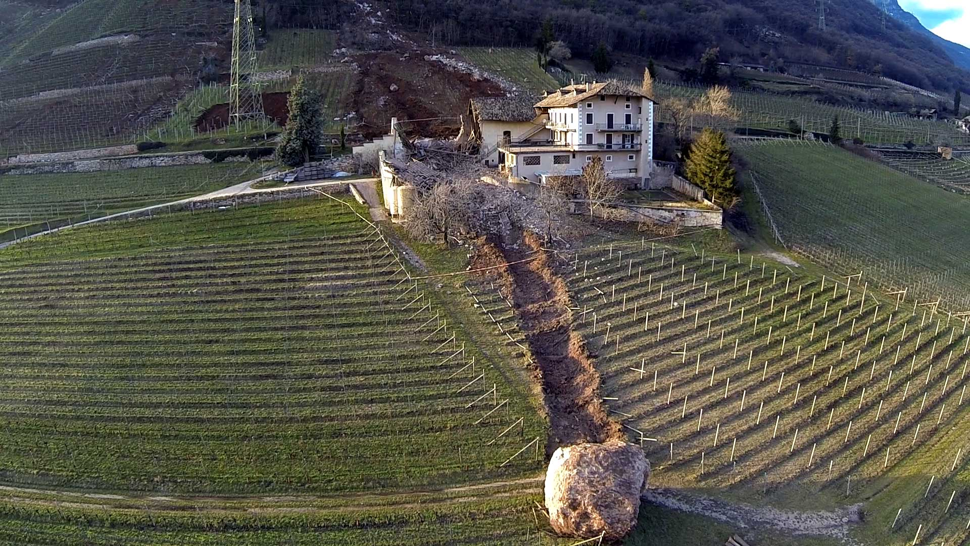 In this handout photo taken on Jan. 23, 2014, a huge boulder is seen after it missed a farm house by less than a meter, destroying the barn, and stopped in the vineyard, while a second giant boulder, which detached during the same landslide on Jan. 21, 2014, stopped next to the house, in Ronchi di Termeno, in Northern Italy.