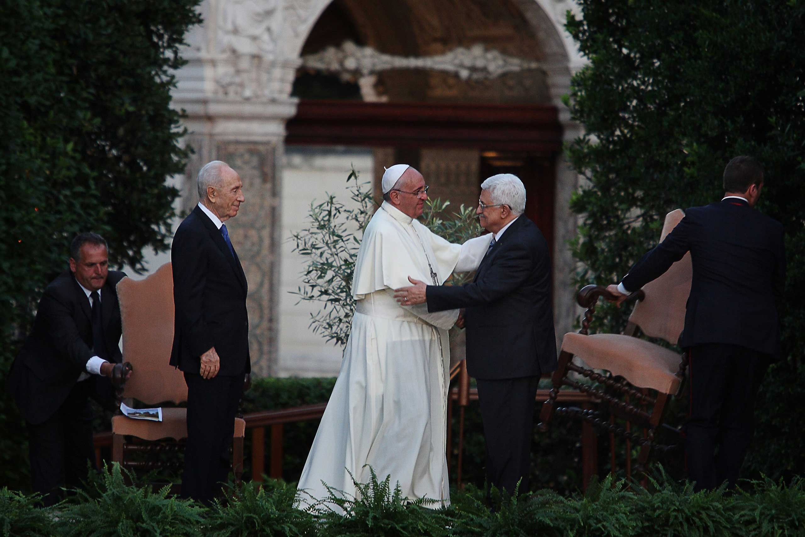 Pope Francis with Palestinian leader Mahmud Abbas and Israeli President Shimon Peres during a joint peace prayer at the Vatican Gardens, Vatican City, June 8, 2014.