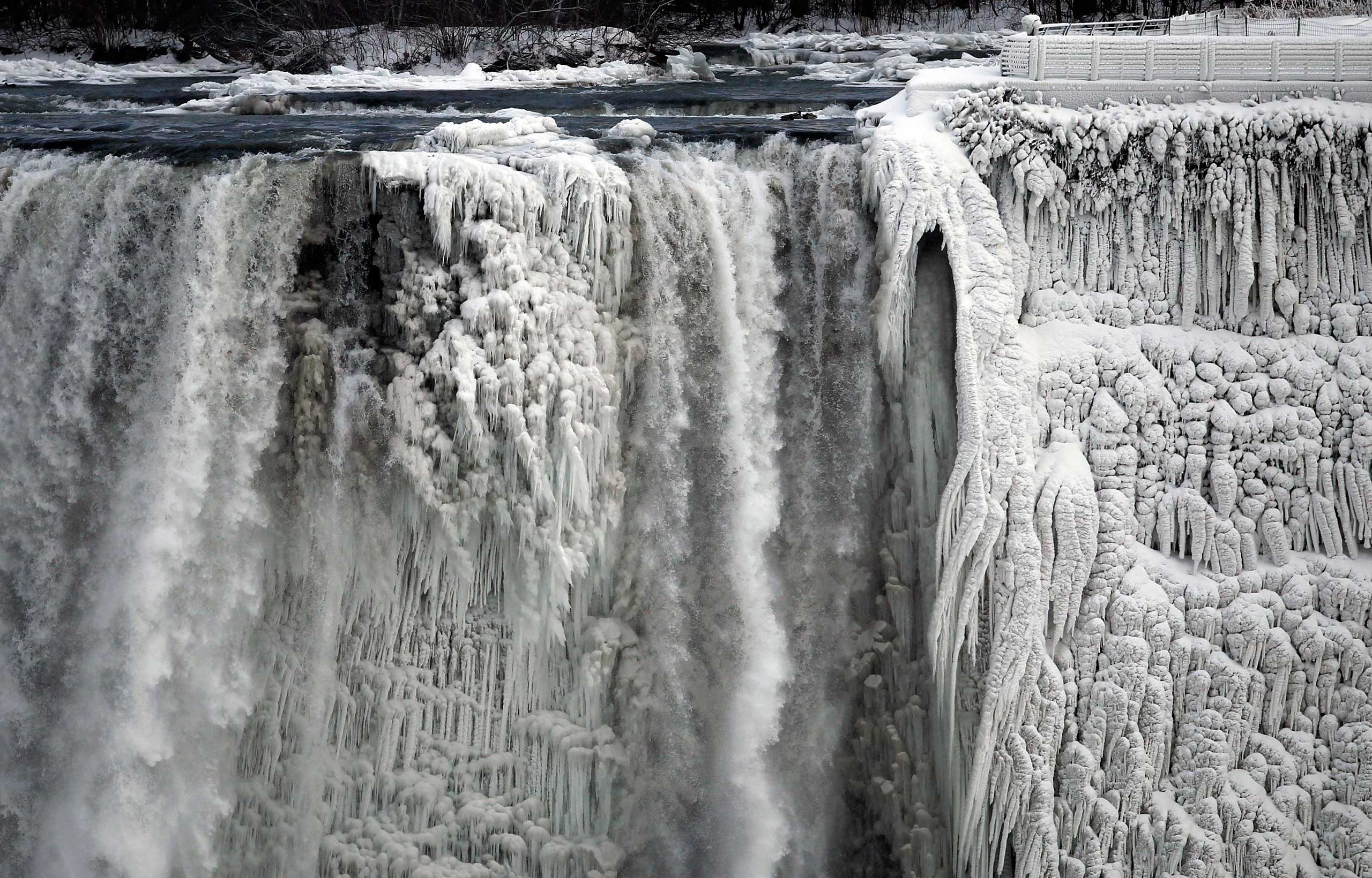 The U.S. side of Niagara Falls, partially frozen from exposure to frigid air from a polar vortex, is pictured from Ont., Canada, Jan. 8, 2014.