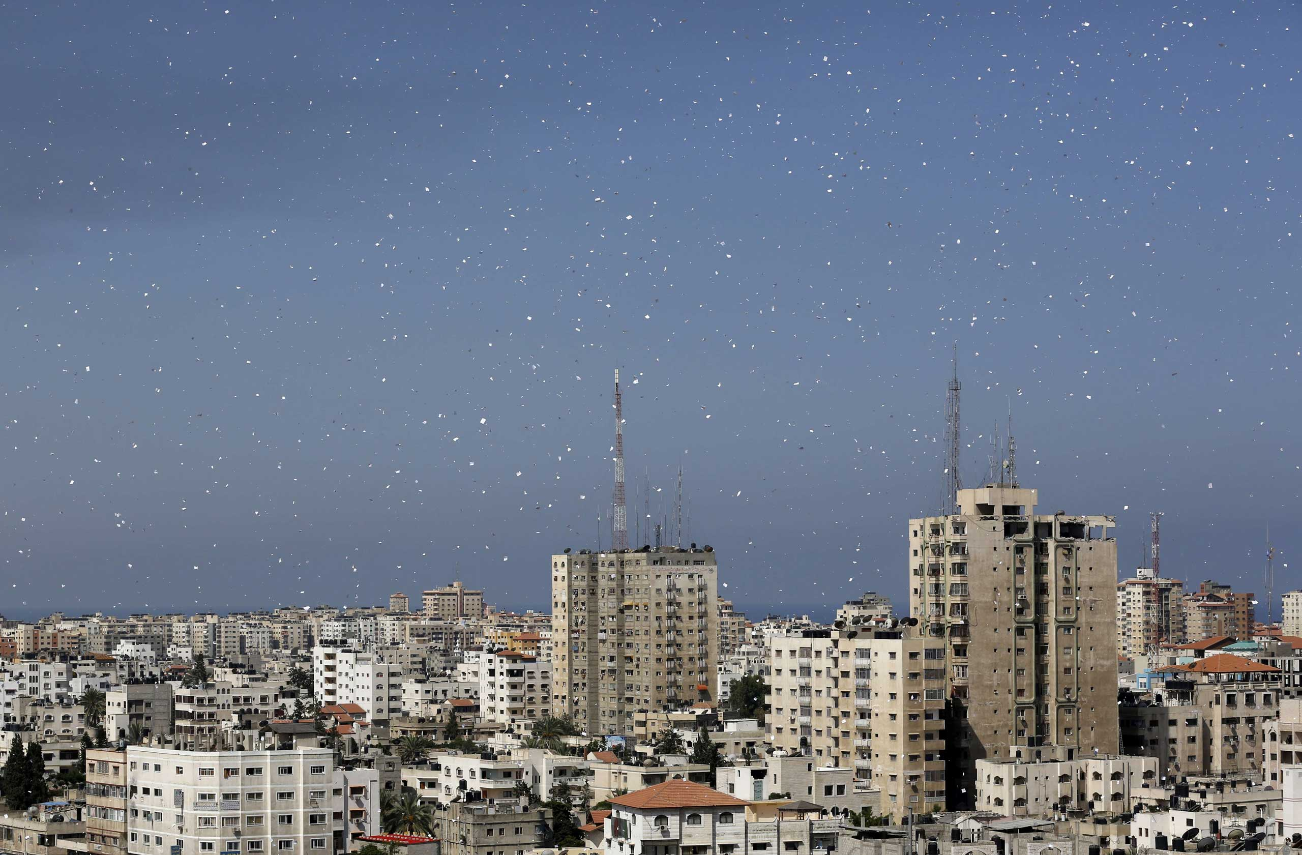 Flyers are dropped over Gaza City by the Israeli army urging residents to evacuate their homes, July 30, 2014.