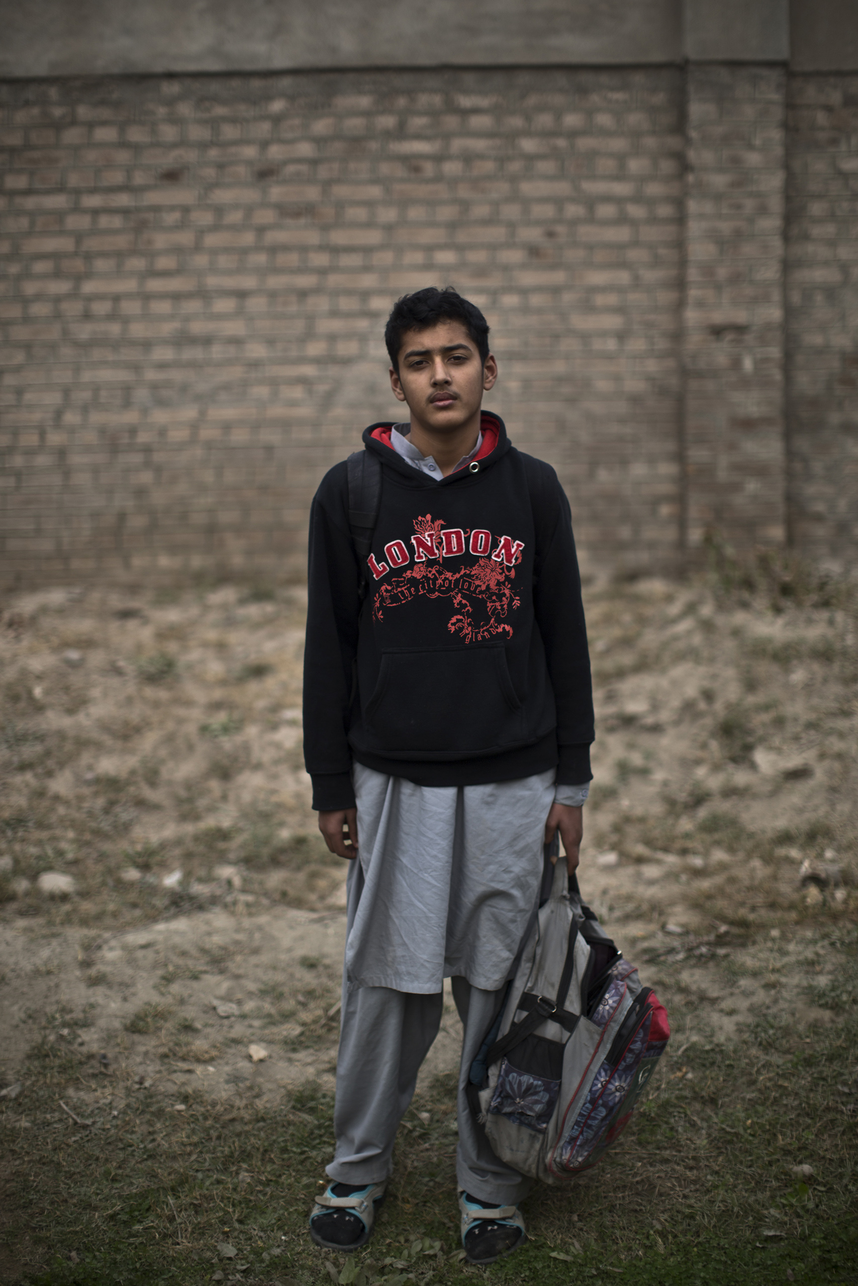 "Batur Khan, 14, a student who survived the Pakistani Taliban's attack on the Army Public School on Dec. 16, in the school's yard. Peshawar, Pakistan. Dec. 20, 2014.                                                                      ""The gunman started shooting randomly. At that moment I ran toward the door, which is close to me, but I was pushed by another boy and I fell on the ground,"" Batur said. ""I stood up so quickly and the sound of the shooting was right behind me and I managed to run out of the door."""