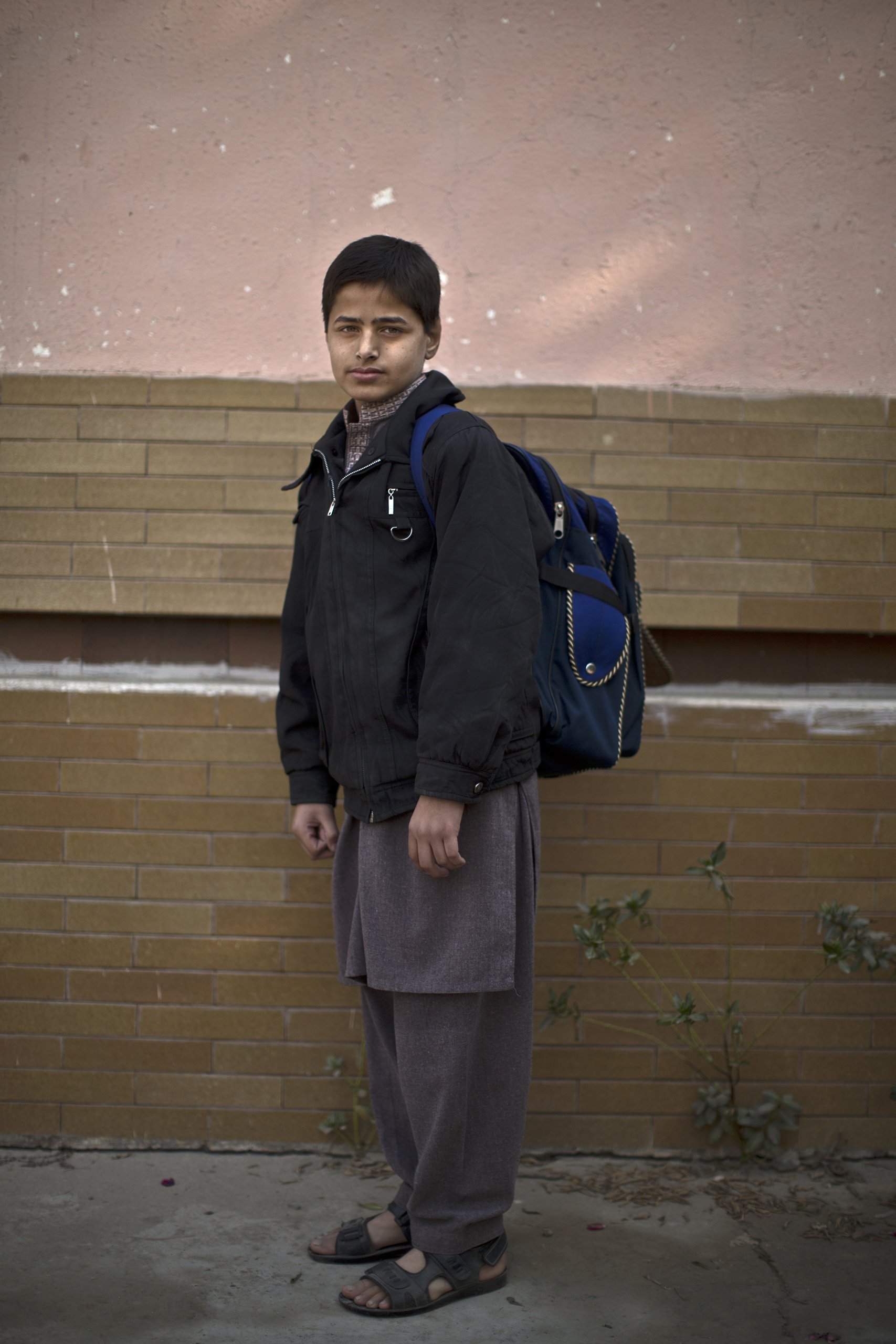 "Faizan Raees, 12, a student who survived the Pakistani Taliban's attack on the Army Public School on Dec. 16, in the school's yard. Peshawar, Pakistan. Dec. 20, 2014.                                                                      ""Our teacher immediately said to us that we were under attack and we have to be quiet and lay on the ground,"" Faizan recalled. ""After 30 minutes, a soldier came to our class."""