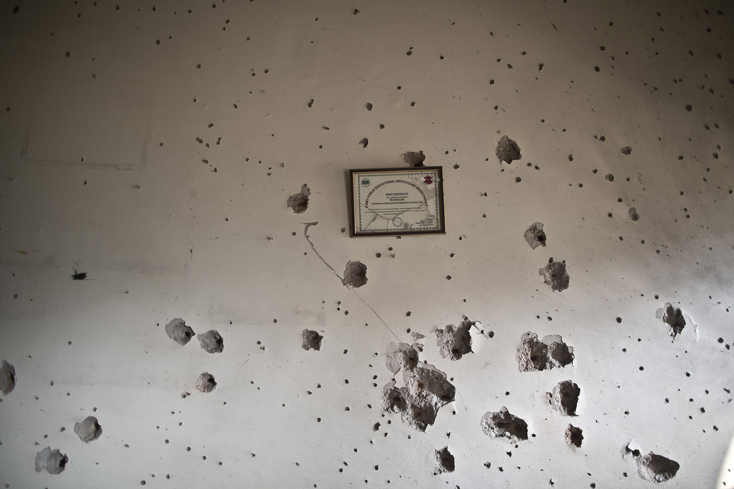 A wall riddled with bullet holes inside the Army Public School, which was attacked on Dec. 16 by the Pakistani Taliban. Peshawar, Pakistan. Dec. 18, 2014.