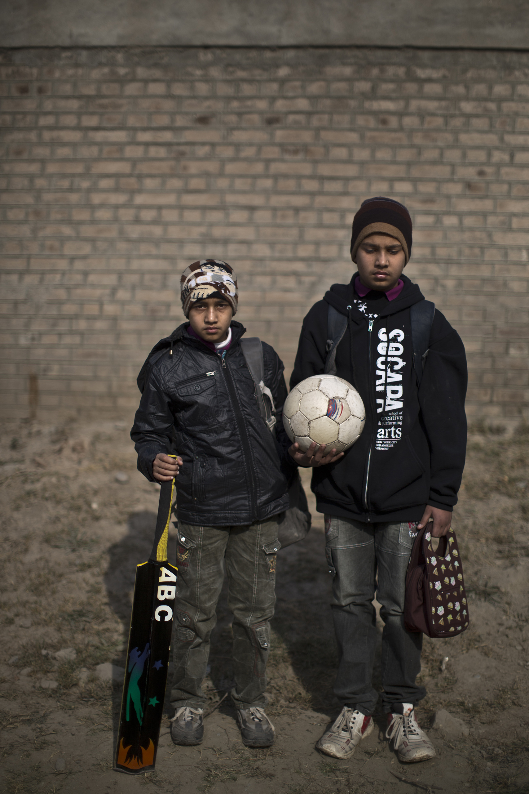 "Muddathir Naveed, 14, (right) and Muzammil, 12, students and brothers who survived the Pakistani Taliban's attack on the Army Public School on Dec. 16, in the school's yard. Peshawar, Pakistan. Dec. 20, 2014.                                                                      ""It's so dangerous to study in Peshawar and so important to me and my family,"" Muddathir said. ""Me and my brother will go back to study in the same school."" Muzammil echoed that sentiment.                                                                      ""I will keep coming to my school, am not afraid anymore,"" he said. ""As my father always said to me, 'Be brave my son,' and I want to be a brave man."""