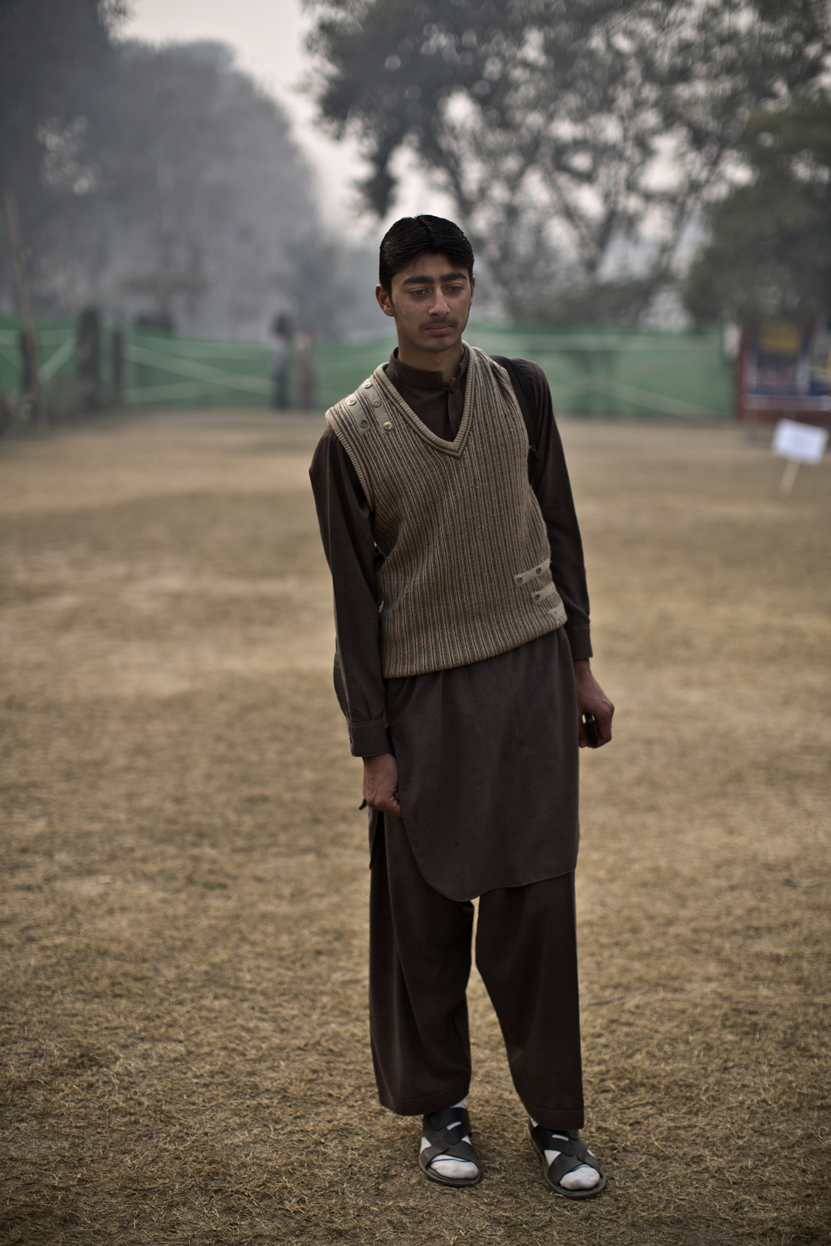 "Afaq Ahmad, 16, a student who survived the Pakistani Taliban's attack on the Army Public School on Dec. 16. Peshawar, Pakistan. Dec. 21, 2014.                                                                      ""Illiteracy is the main reason of terrorism,"" Afaq said. ""To fight it we have all to be educated."""
