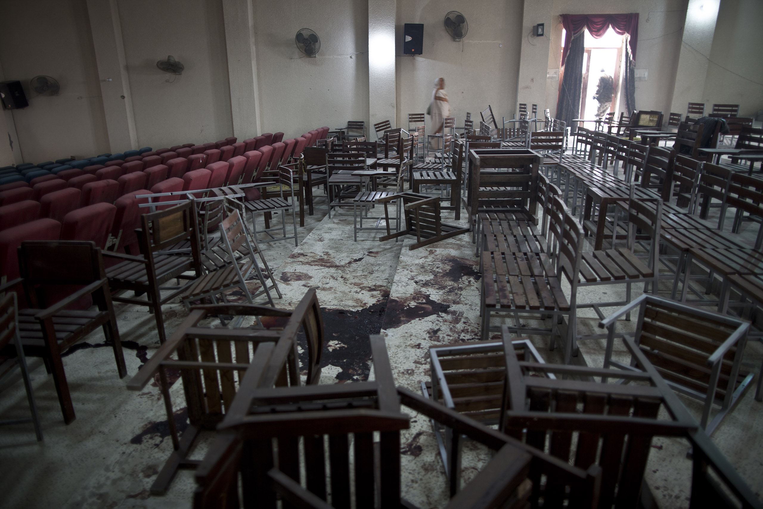 Chairs in the auditorium are overturned and the floor is stained with blood after the Pakistani Taliban attacked the Army Public School on Dec. 16. Peshawar, Pakistan. Dec. 18, 2014.