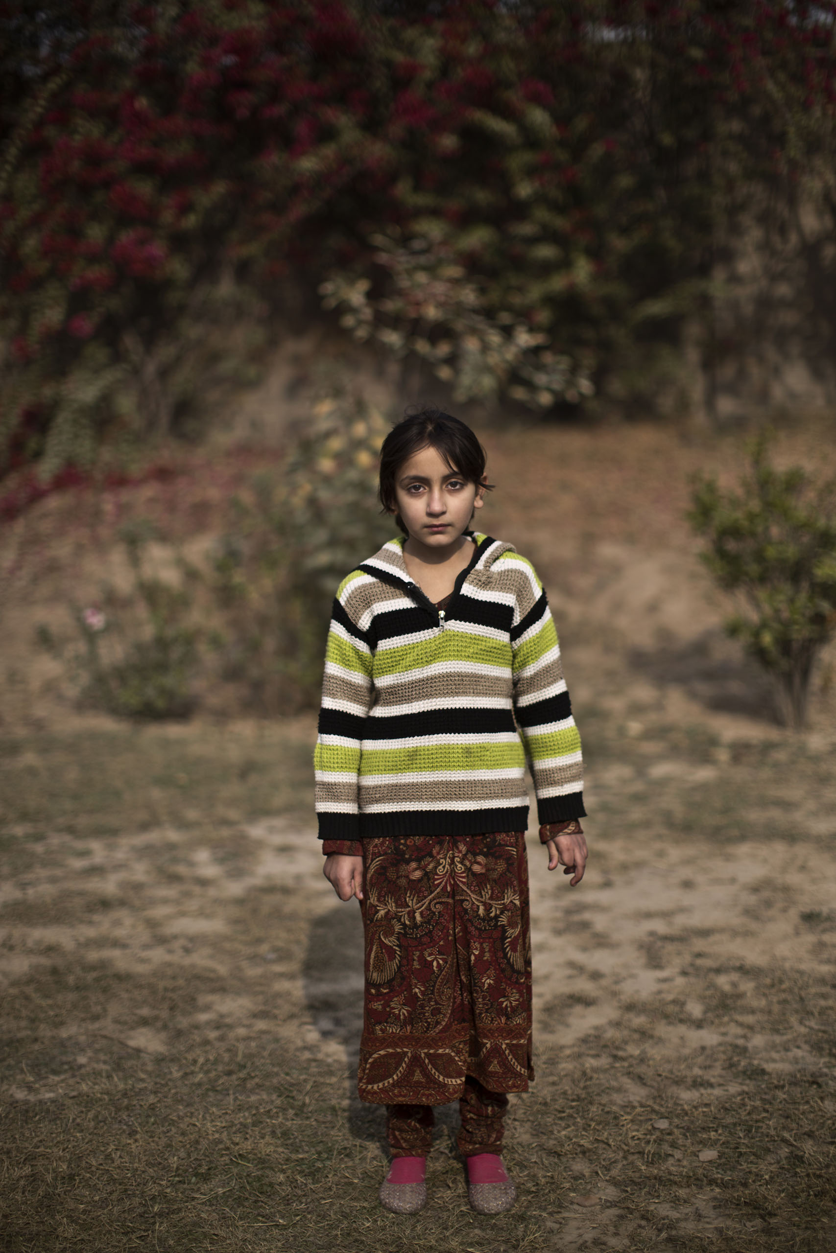"Mesbah Hadait, 7, a student who survived the Pakistani Taliban's attack on the Army Public School on Dec. 16, in the school's yard. Peshawar, Pakistan. Dec. 20, 2014.                                                                      ""I remember nothing of that day,"" Mesbah said. ""I have no memory of it."""