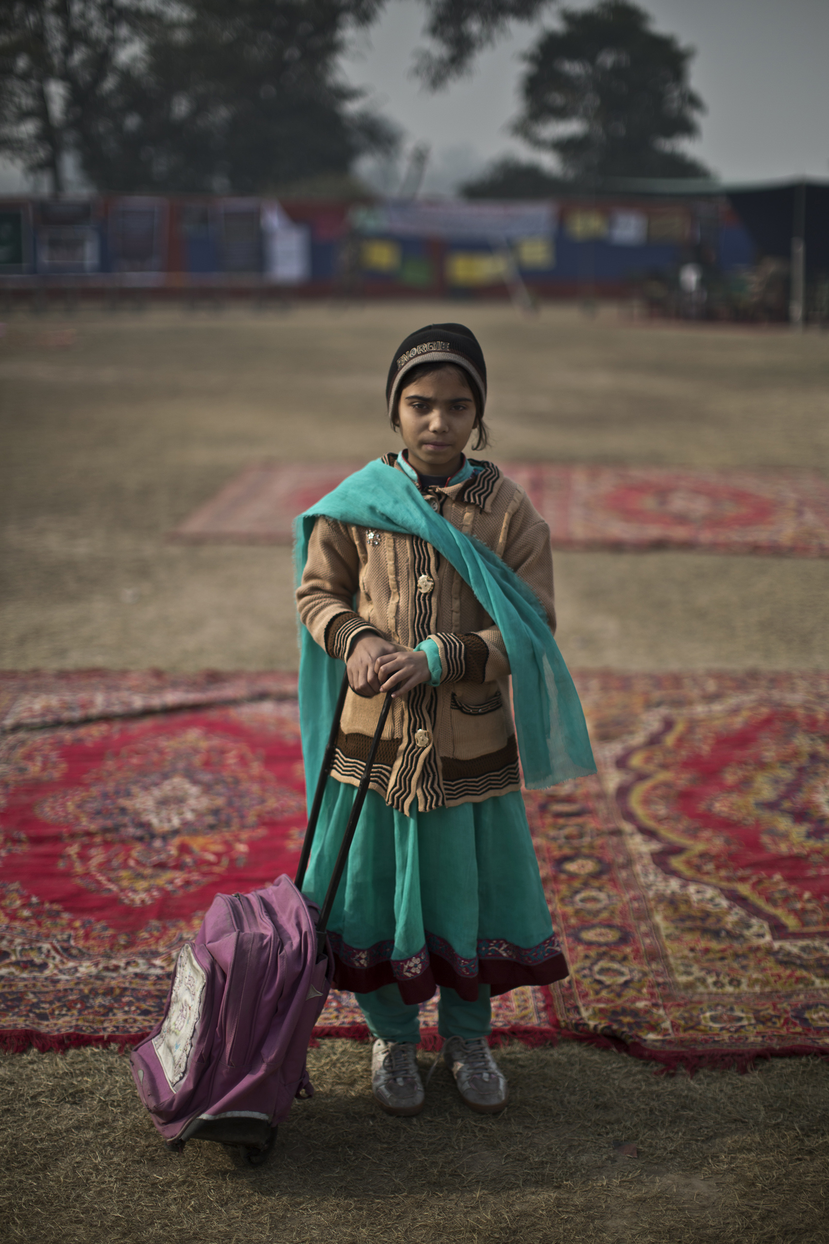 "Hina Gul, 8, a student who survived the Pakistani Taliban's attack on the Army Public School on Dec. 16, in the school's yard. Peshawar, Pakistan. Dec. 20, 2014.                                                                      ""Inshallah, I will come back to my school,"" Hina said."