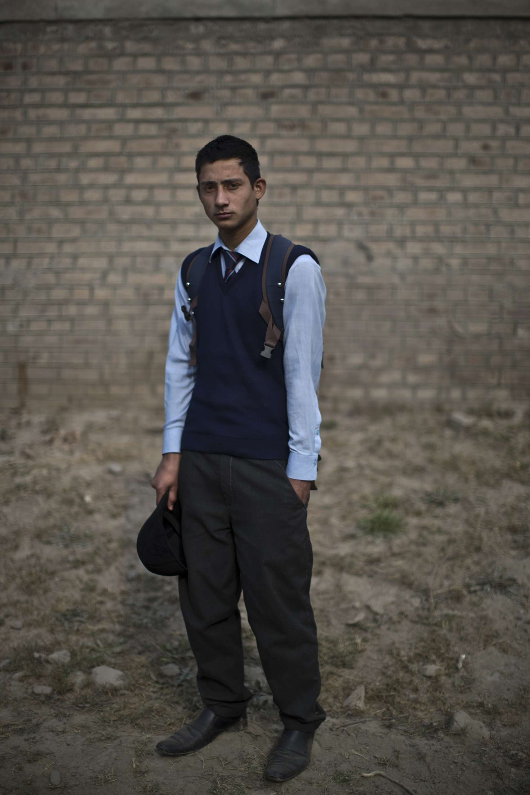 "Bilal Ahmad, 16, a student who survived the Pakistani Taliban's attack on the Army Public School on Dec. 16, in the school's yard. Peshawar, Pakistan. Dec. 20, 2014.                                                                      ""For almost an hour we were on the ground silently hearing our own breaths,"" Bilal said. ""And the sound of firing was endless till soldiers arrived and grabbed us and took us through the back doors out of the school."""