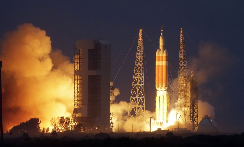 NASA's Orion spacecraft, atop a United Launch Alliance Delta 4-Heavy rocket, lifts off on its first unmanned orbital test flight from the Cape Canaveral Air Force Station on Dec. 5, 2014, in Cape Canaveral, Fla.