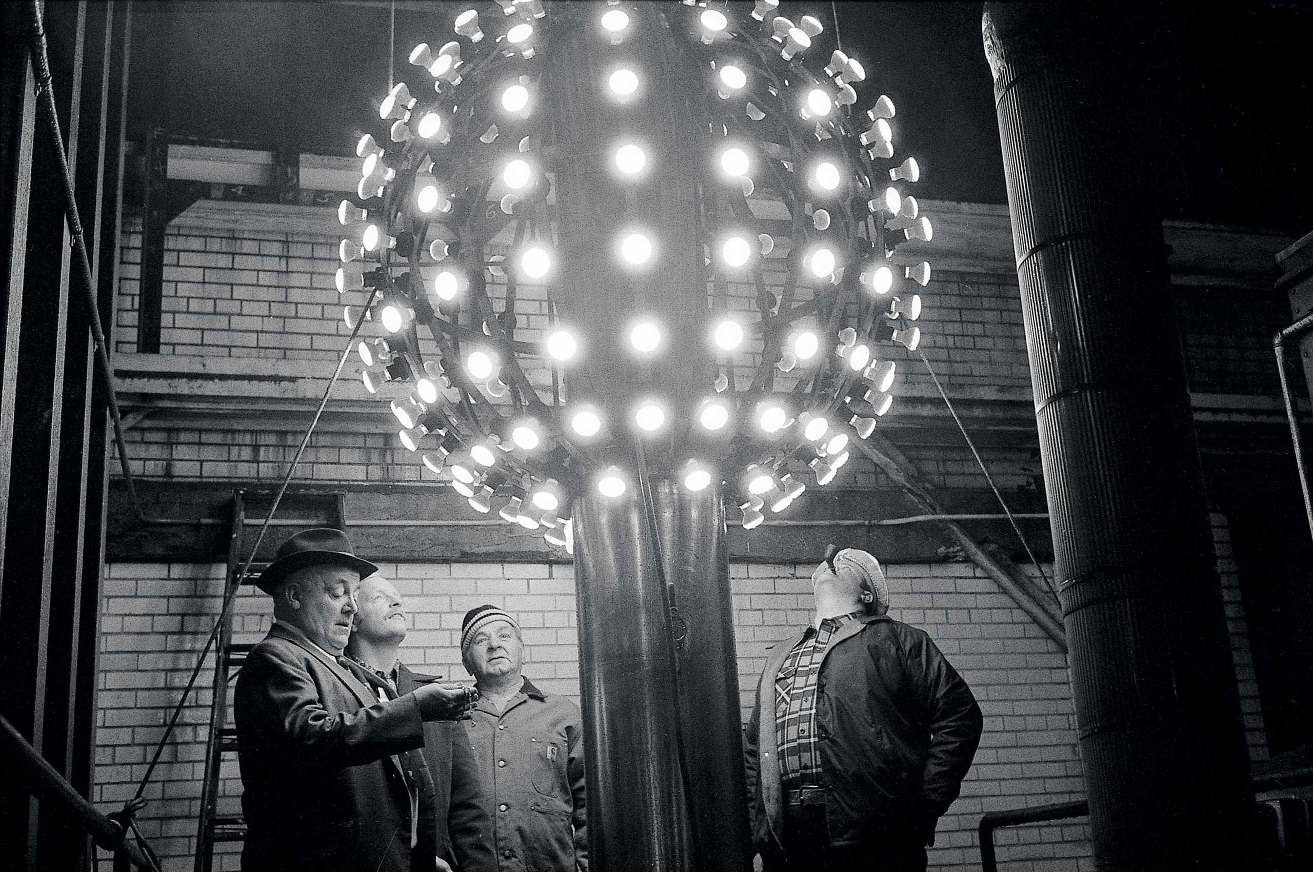Technicians eye the new improved New Years ball, with halogen lamps for greater visibility, in New York City in 1978.