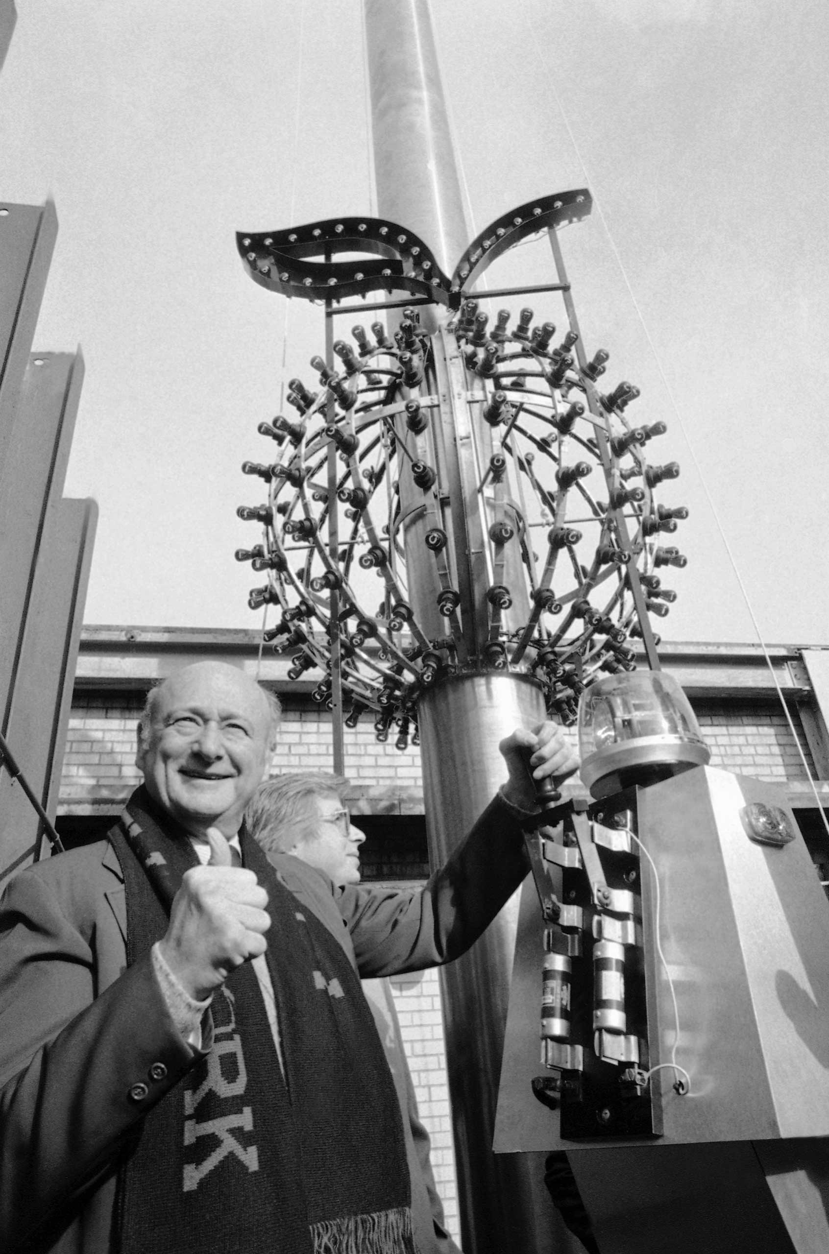 New York City Mayor Ed Koch gives the thumbs up sign as he flips a switch to test the Big Apple Ball on Dec. 24, 1981 in New York City.