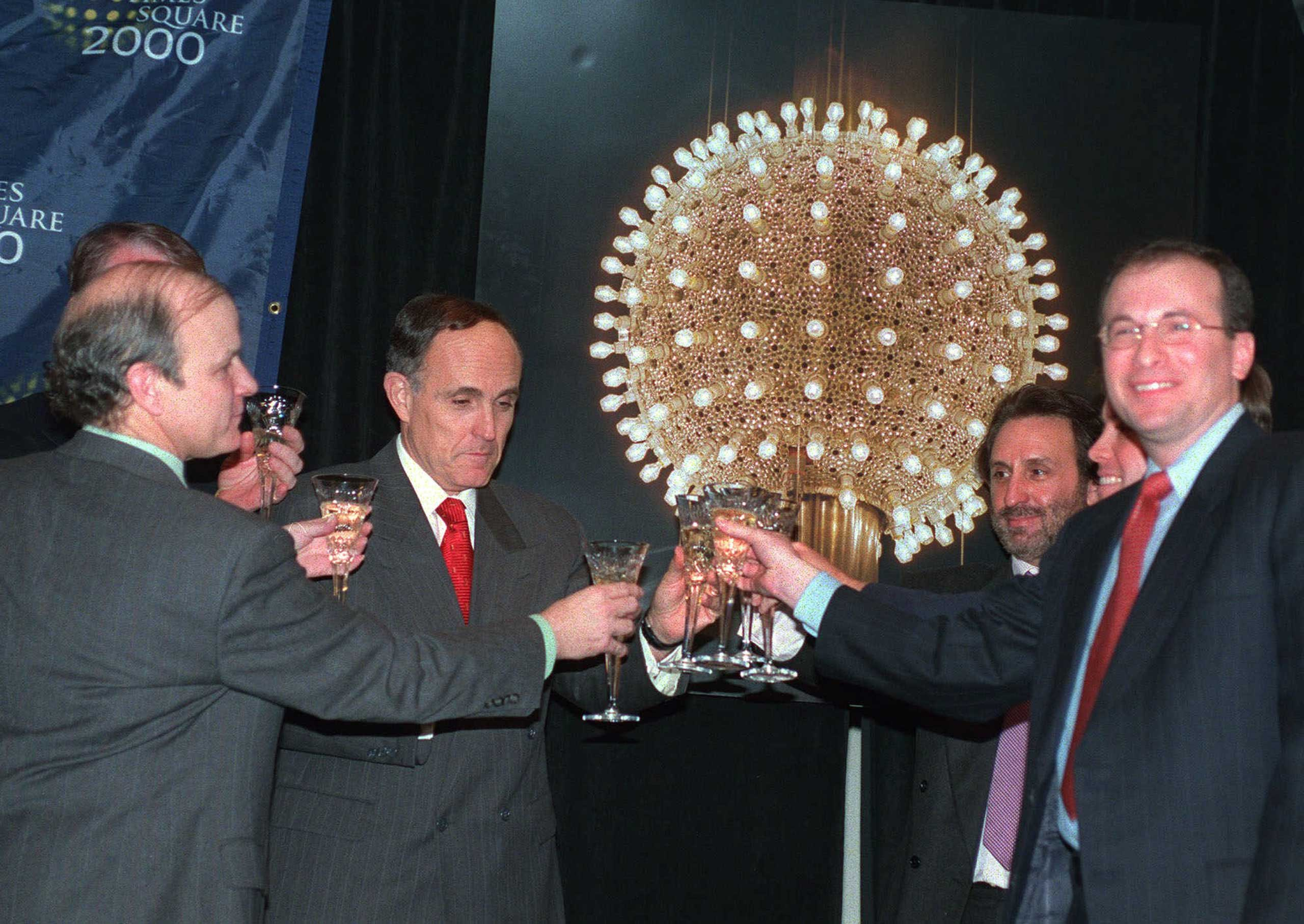 Times Square Business Improvement District President Brendan Sexton, left, New York City Mayor Rudolph Giuliani, second from left, actor and Chairman of New York City 2000 Ron Silver, right rear, and President of Countdown Entertainment Jeffrey A. Straus, right, make a toast at a press conference in New York City on, Dec. 28, 1998.