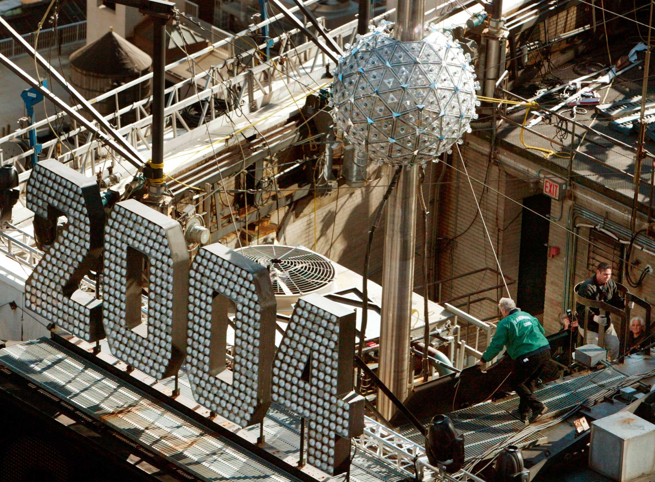 Workers test a giant 1,070-pound, six-foot diameter Waterford Crystal ball,  in New York City on Dec. 30, 2003.