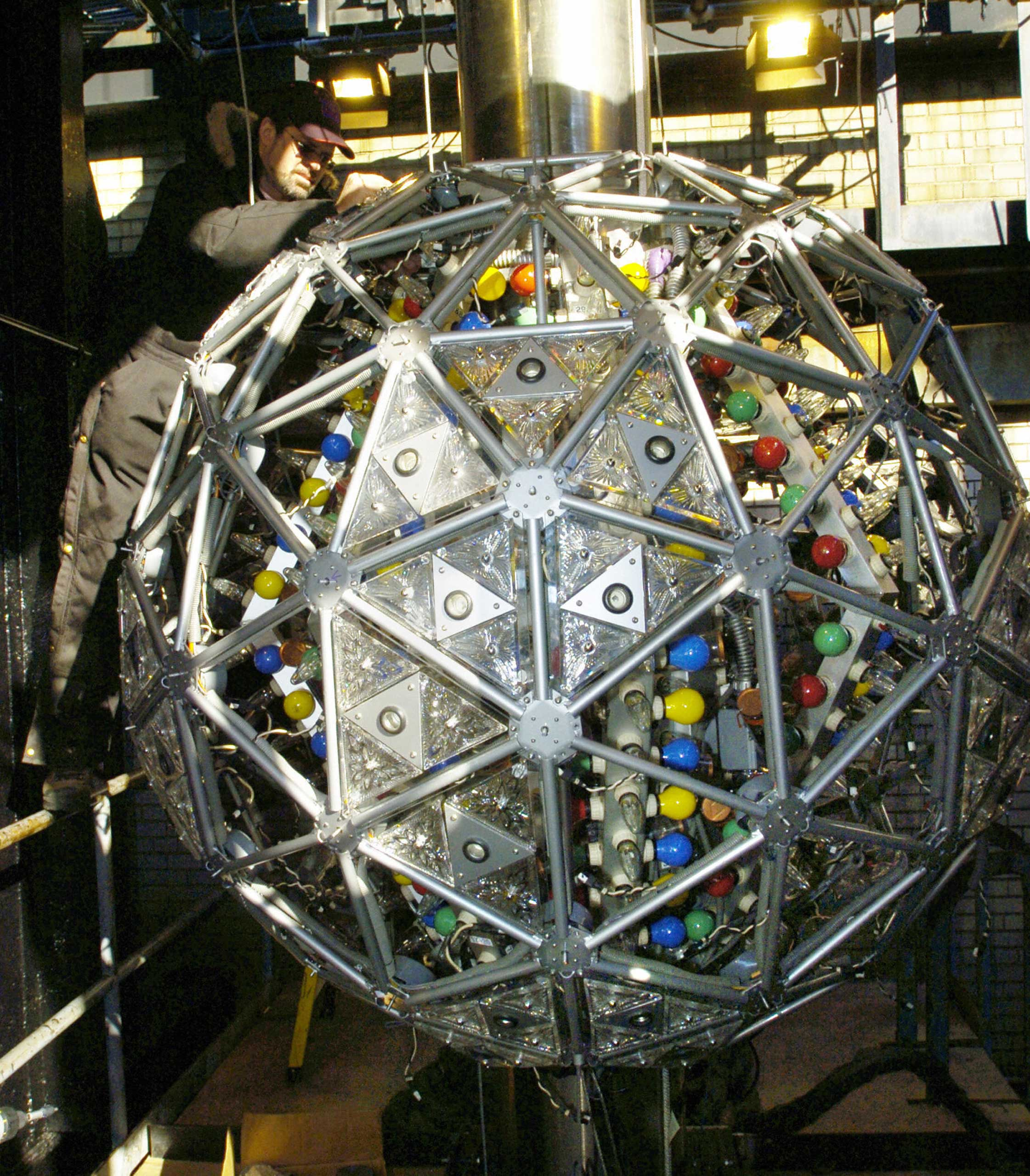 A workman installs one of 72 new Waterford Crystal triangles, featuring the  Hope for Fellowship  design, on the exterior of the Times Square New Year's Eve Ball in New York City on Dec. 28, 2005.