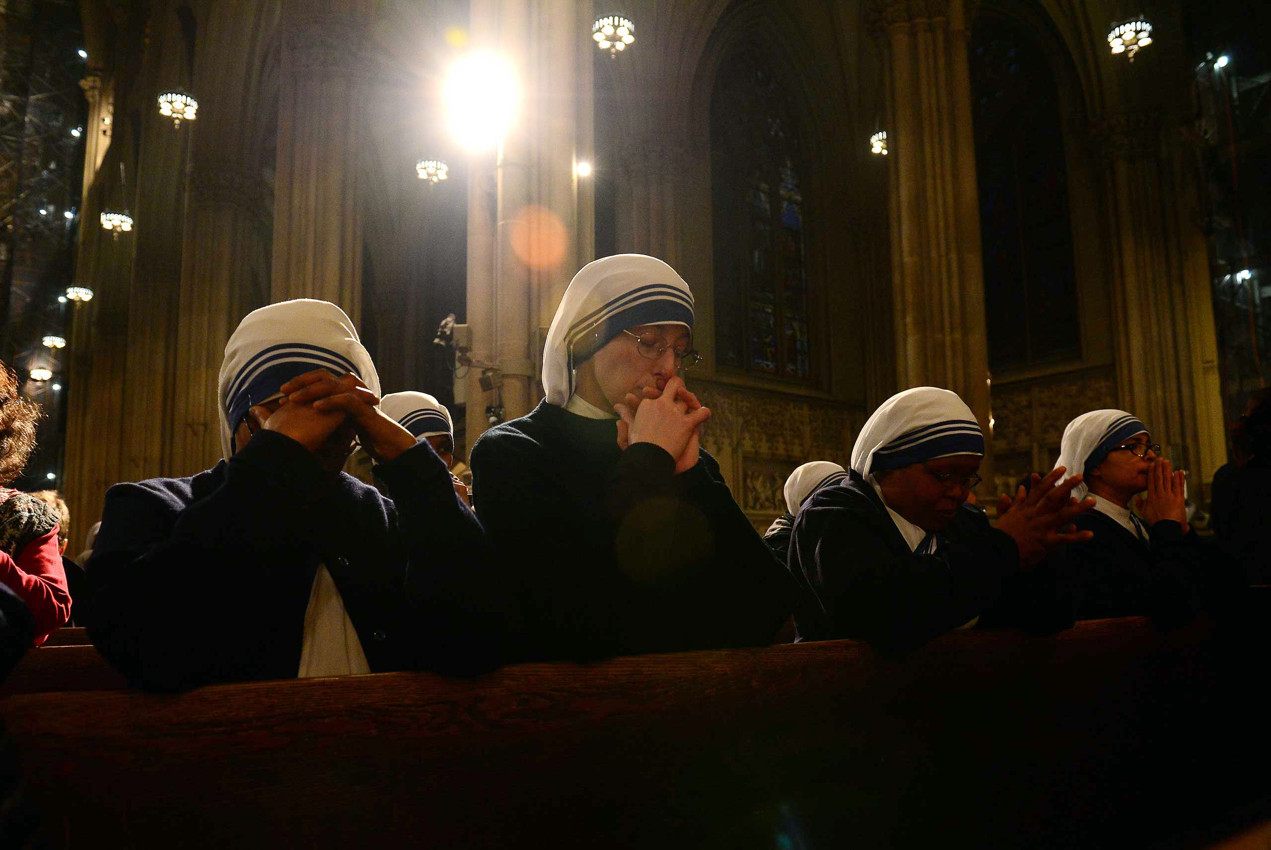 Nuns pray during a mass in celebration of Pope Benedict XVI at St. Patrick's Cathedral in New York, Feb. 28, 2013.
