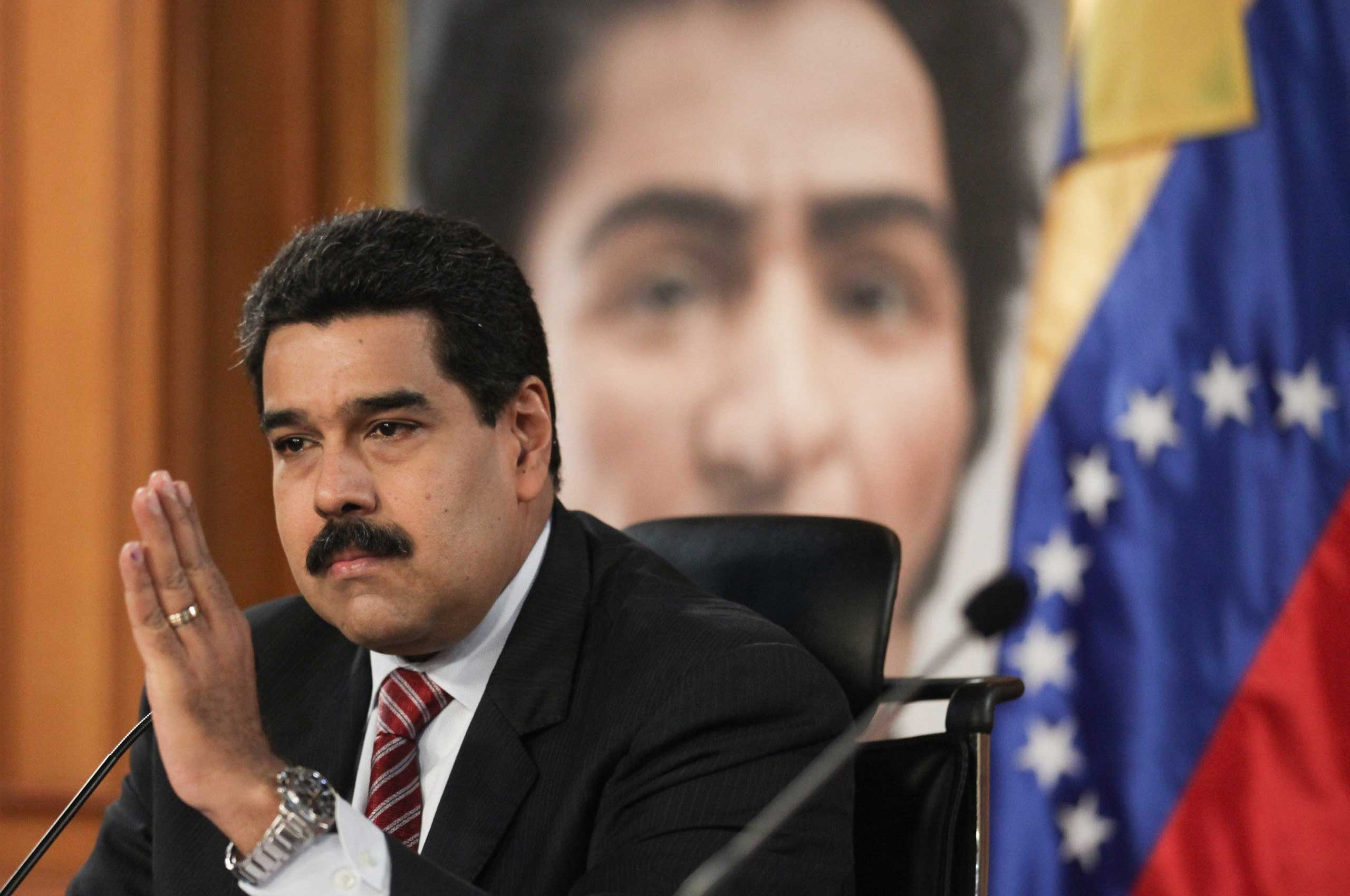 President Nicolas Maduro takes part in a press conference in Caracas, Venezuela, on Dec. 2, 2014.