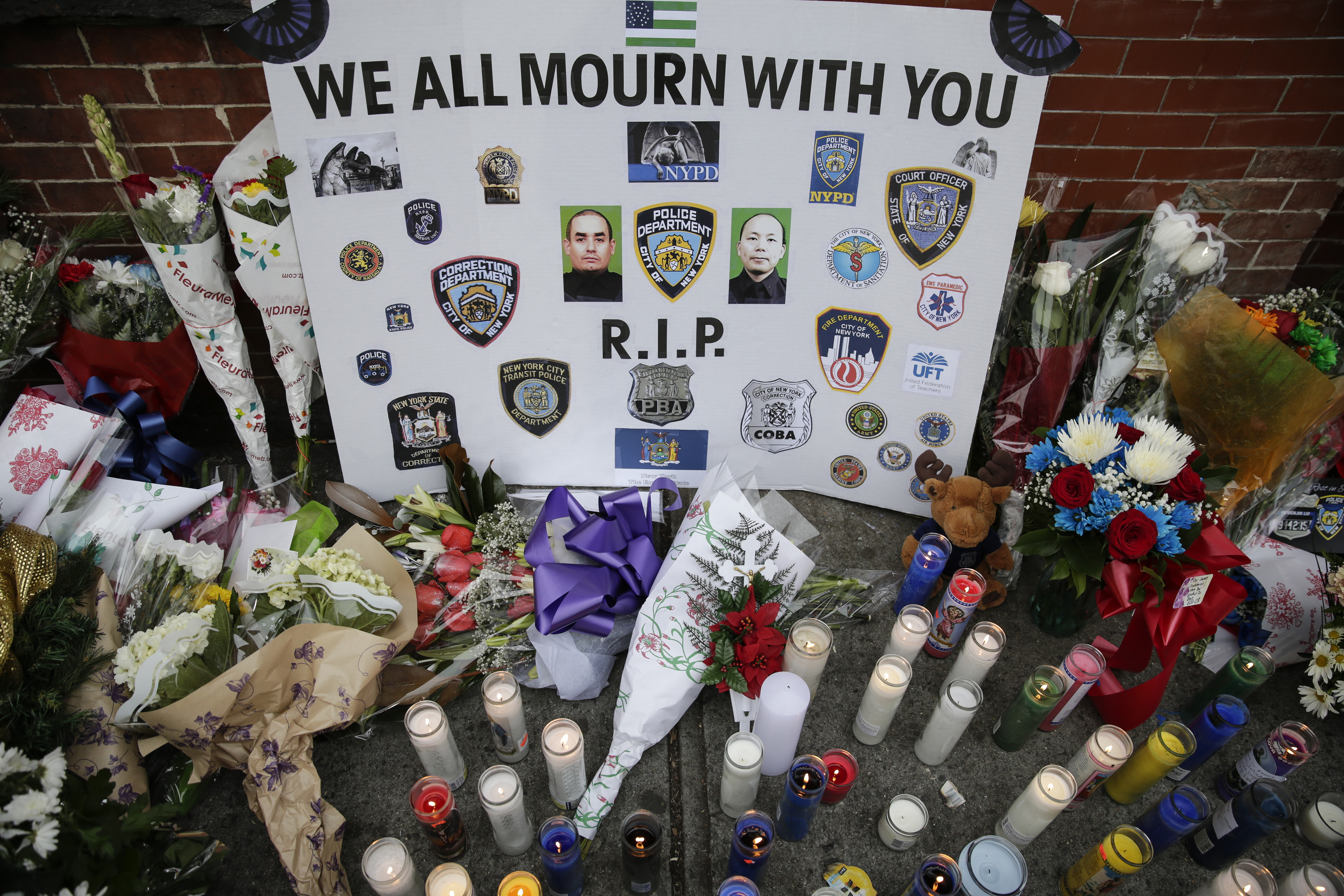 A view of the memorial for slain NYPD officers, Wenjian Liu and Rafael Ramos, on Tompkins Ave. and Myrtle Ave. where two officers were murdered, in Brooklyn, N.Y. on Dec. 22, 2014.